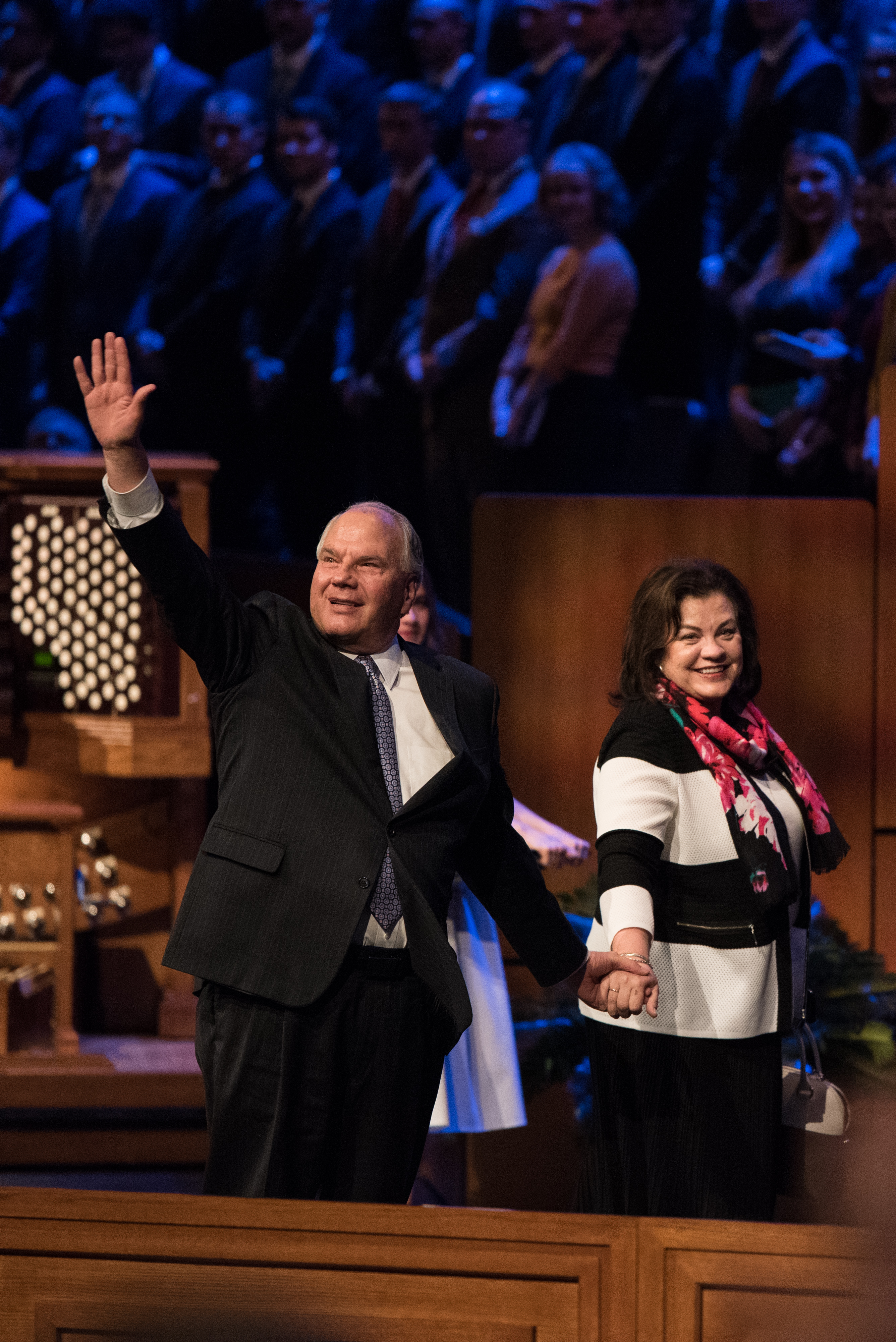 Elder Ronald A. Rasband waves to students as he and his wife, Sister Melanie Rasband, leave following a devotional held on April 28, 2019.