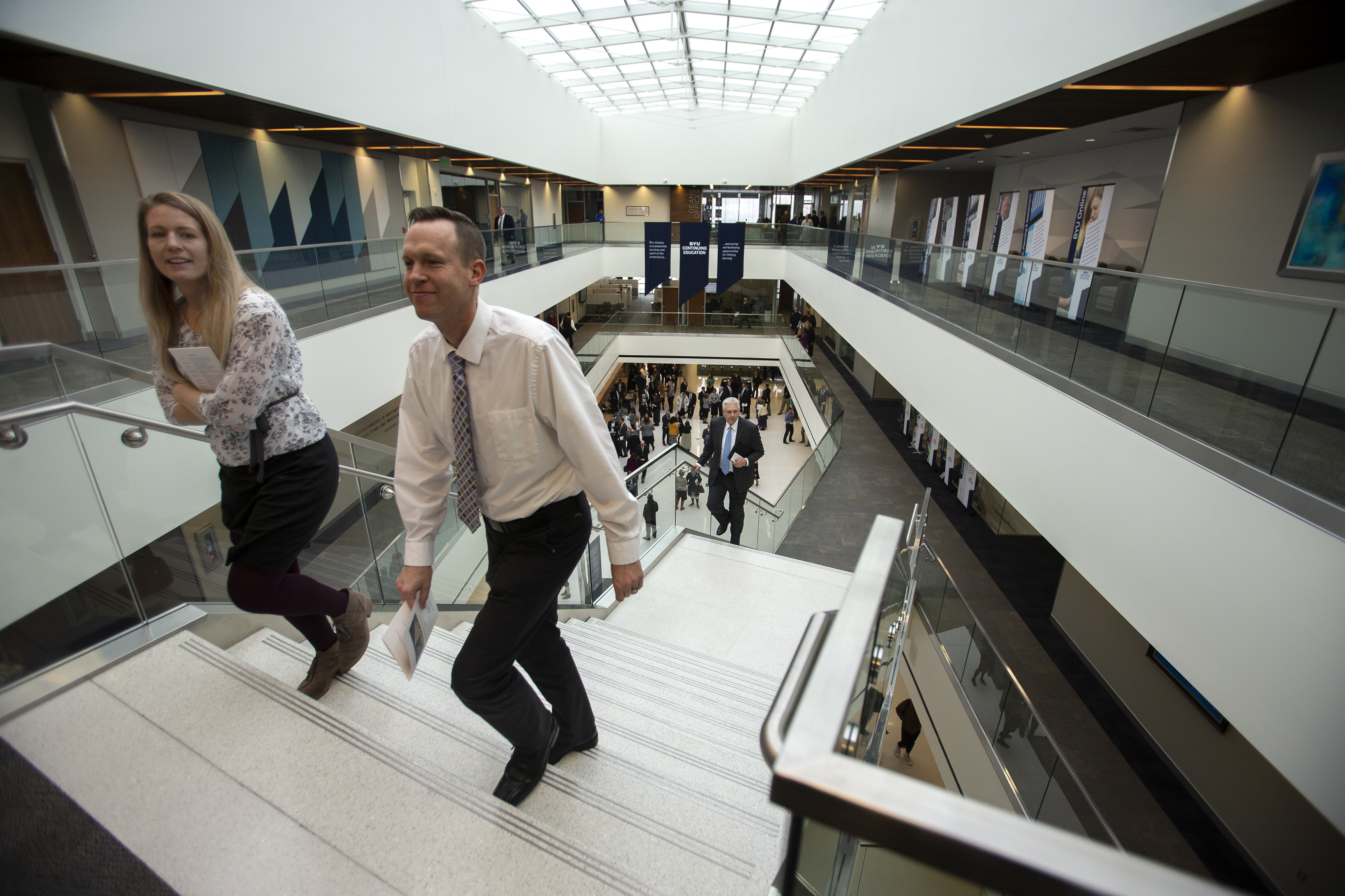 Jessica Bryan and Joel Hemingway walk up the stairs of the Caroline Hemenway Harman Building after Elder Ulisses Soares of the Quorum of the Twelve Apostles gave the rededication prayer at BYU in Provo, Utah, on Tuesday, Feb. 5, 2019.