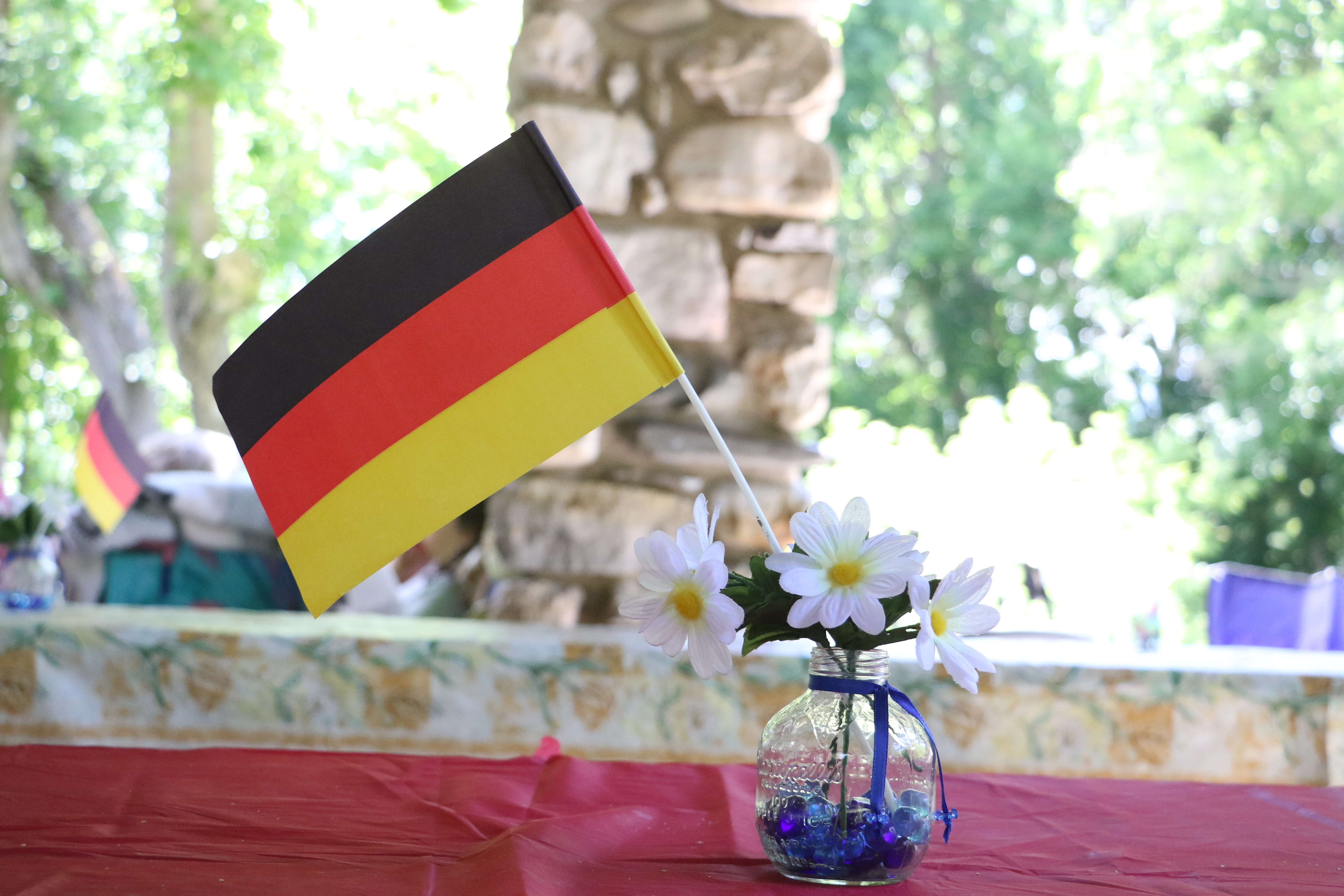 A German flag decoration rests on a table at the German Speaking Ward's annual ward picnic at Washington Terrace Park on July 13, 2019.