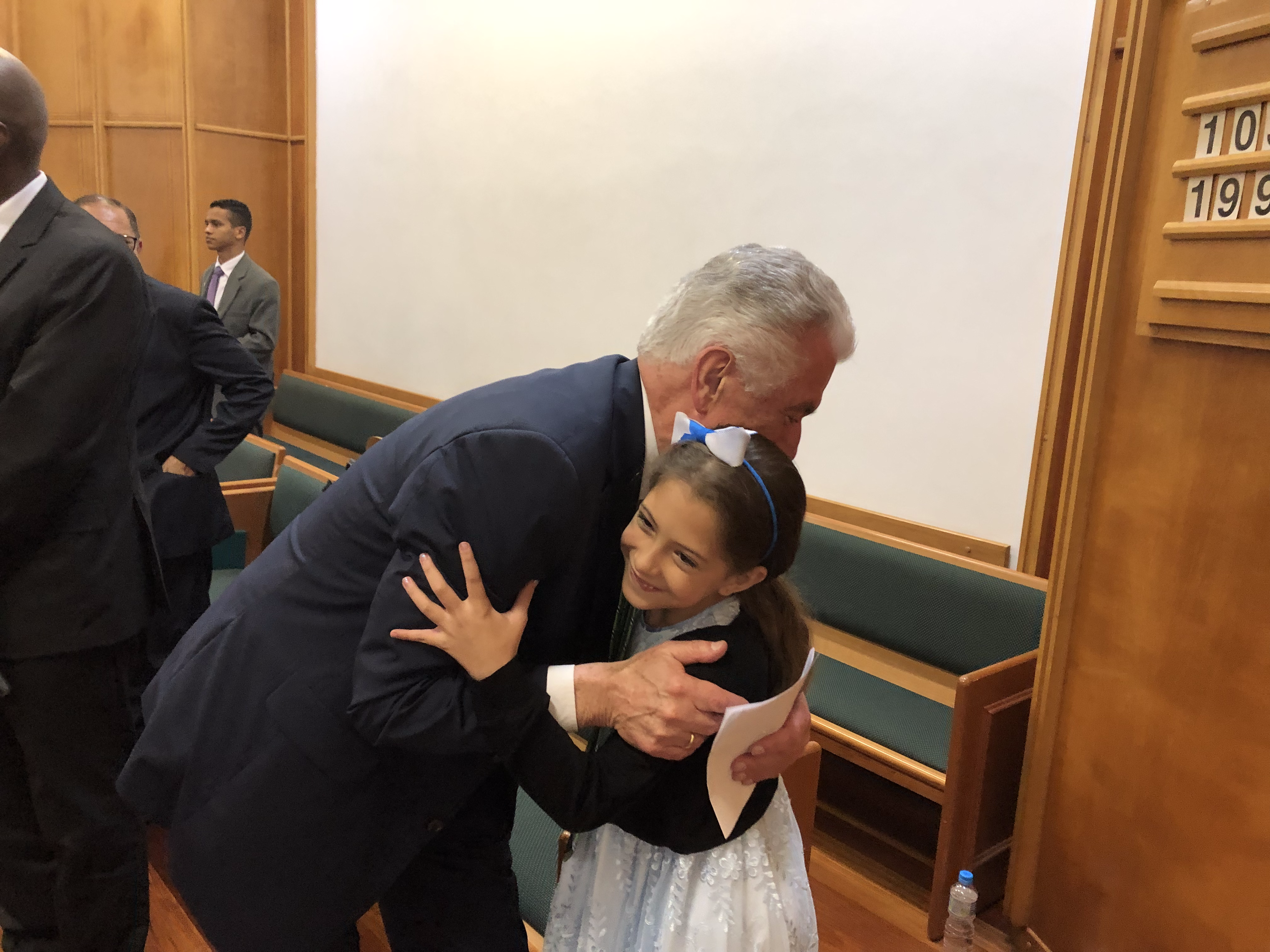 After a young child of the Jaraguá Ward of the Sao Paulo Brazil Jaragua Stake rushed up to give him a post-meeting hug, Elder Dieter F. Uchtdorf of the Quorum of the Twelve Apostles returns the gesture in February 2019.