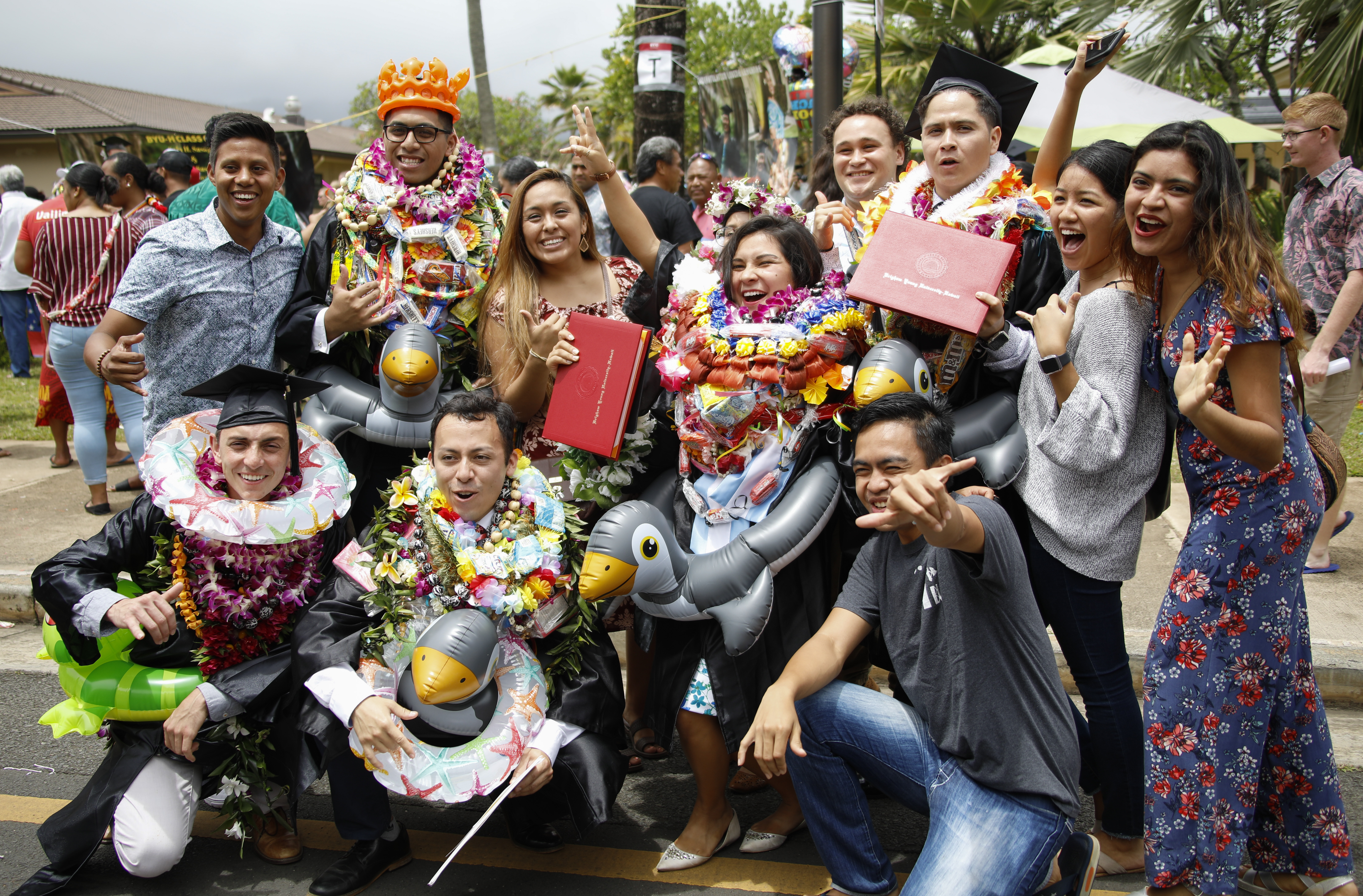 Graduates celebrate with family and friends following the BYU-Hawaii Winter Semester Commencement ceremony on April 20, 2019.