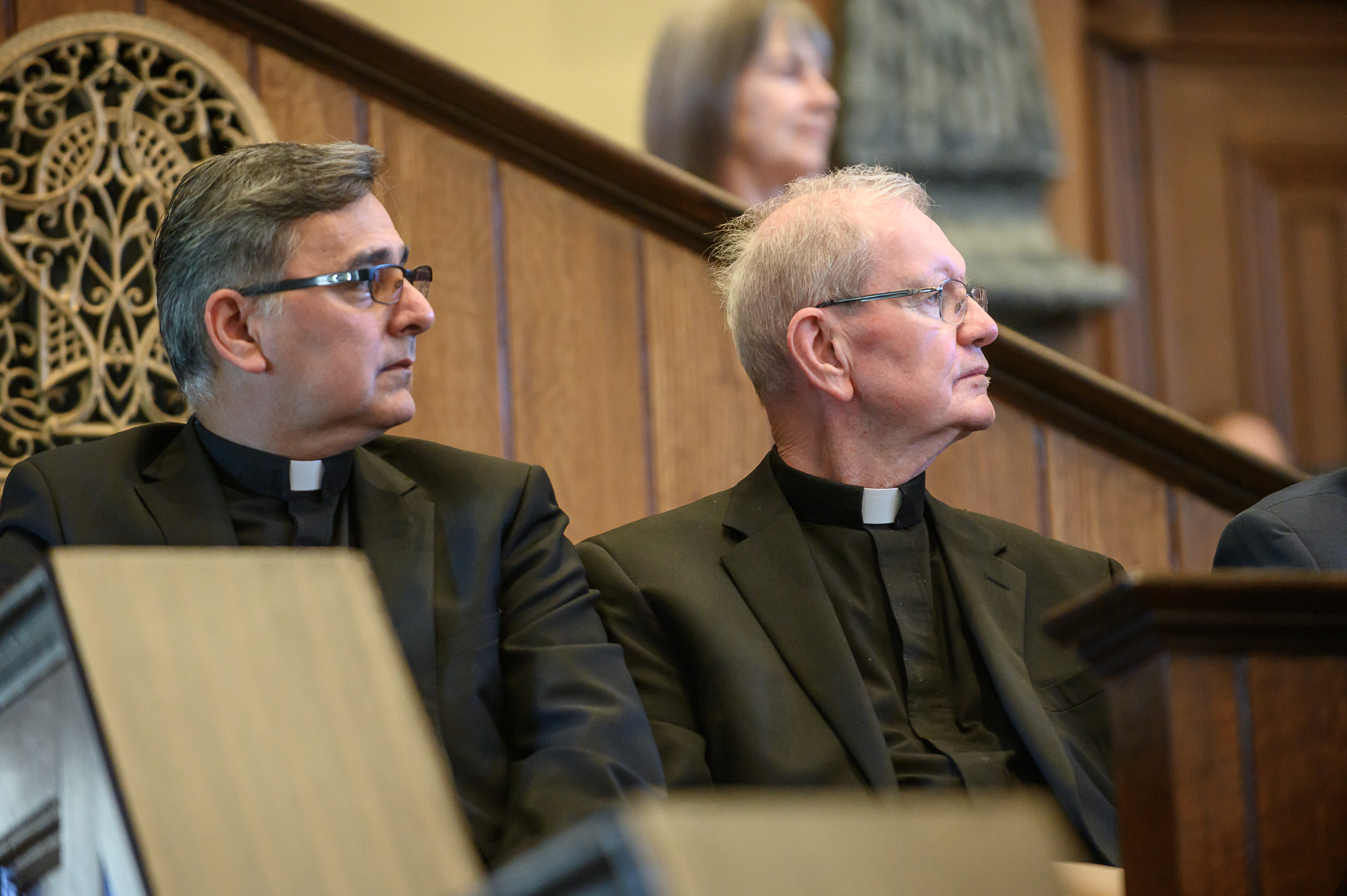 Father Oscar Martin Picos (left), Saint George Catholic Church, and Reverend Monsignor Terence Moore listen at the Historic Interfaith Tribute at the St. George Tabernacle in St. George, Utah on Thursday, May 2, 2019.
