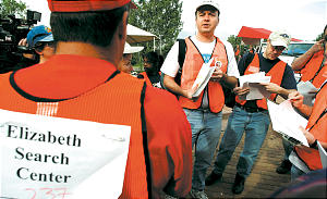 A volunteer team reviews its search assignments.