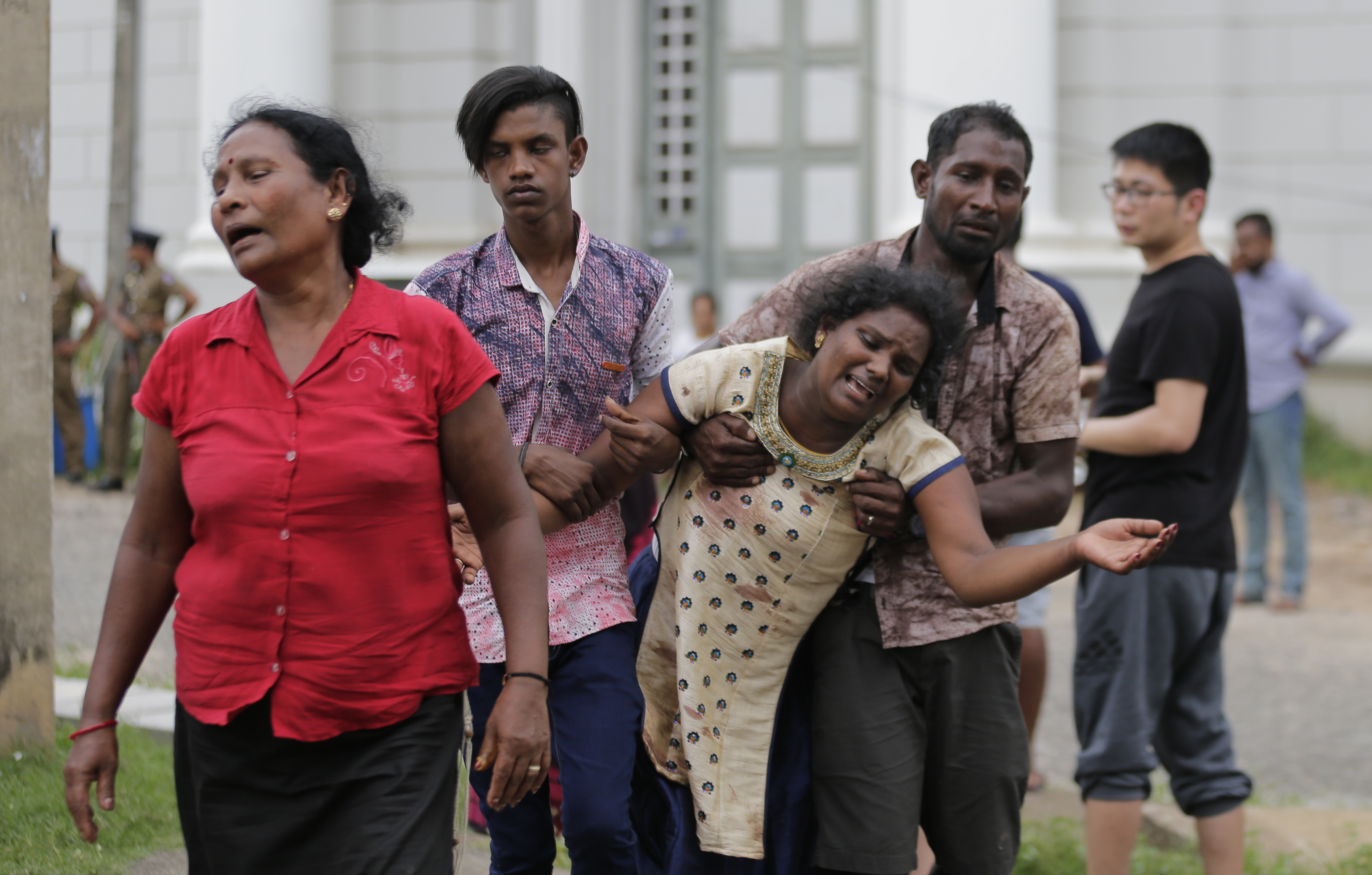 Relatives of a blast victim grieve outside a morgue in Colombo, Sri Lanka, Sunday, April 21, 2019. More than hundred were killed and hundreds more hospitalized with injuries from eight blasts that rocked churches and hotels in and just outside of Sri Lanka's capital on Easter Sunday, officials said, the worst violence to hit the South Asian country since its civil war ended a decade ago.