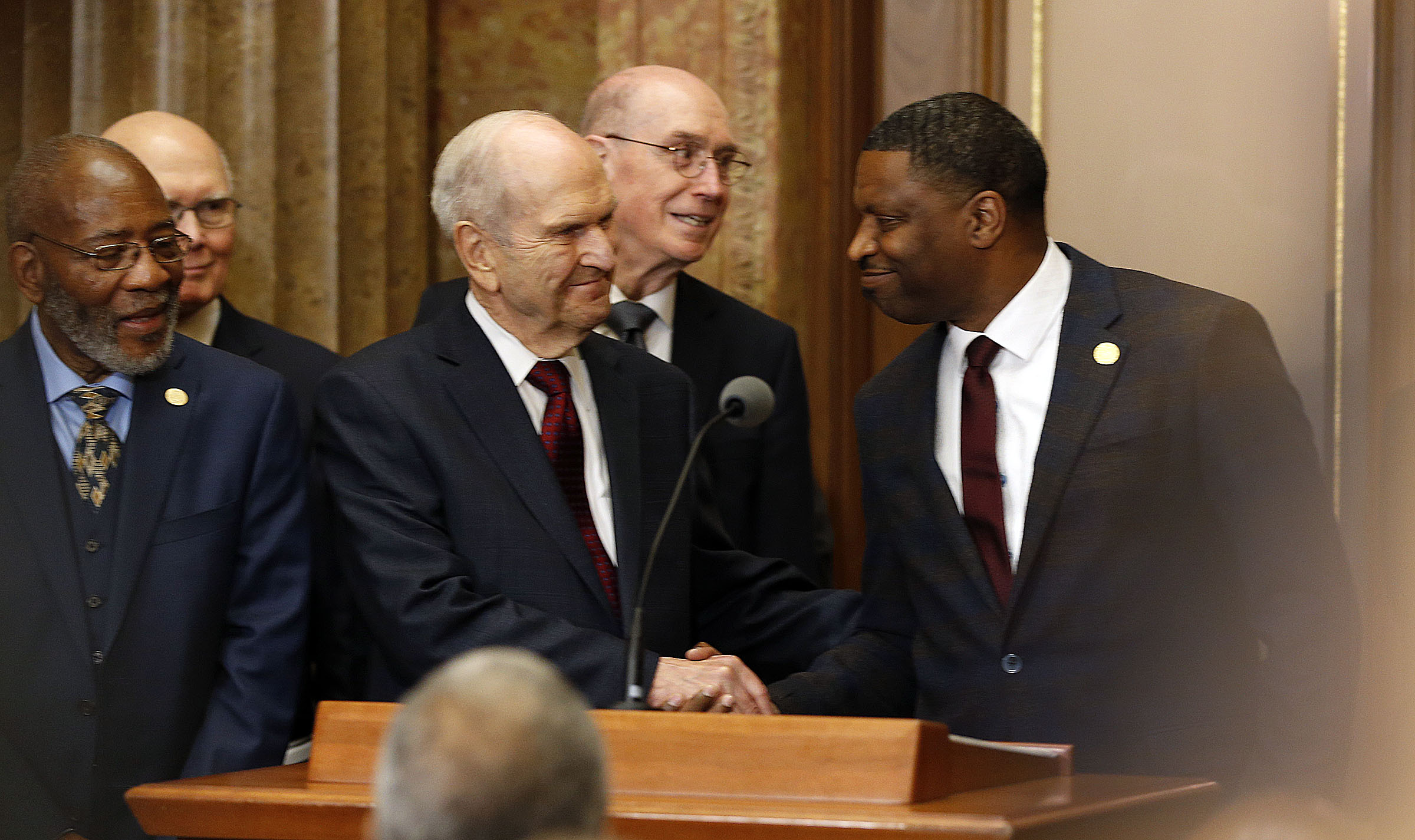 President Russell M. Nelson of The Church of Jesus Christ of Latter-day Saints shakes hands with Derrick Johnson, president and CEO of the NAACP, right, during a press conference in Salt Lake City on Thursday, May 17, 2018.