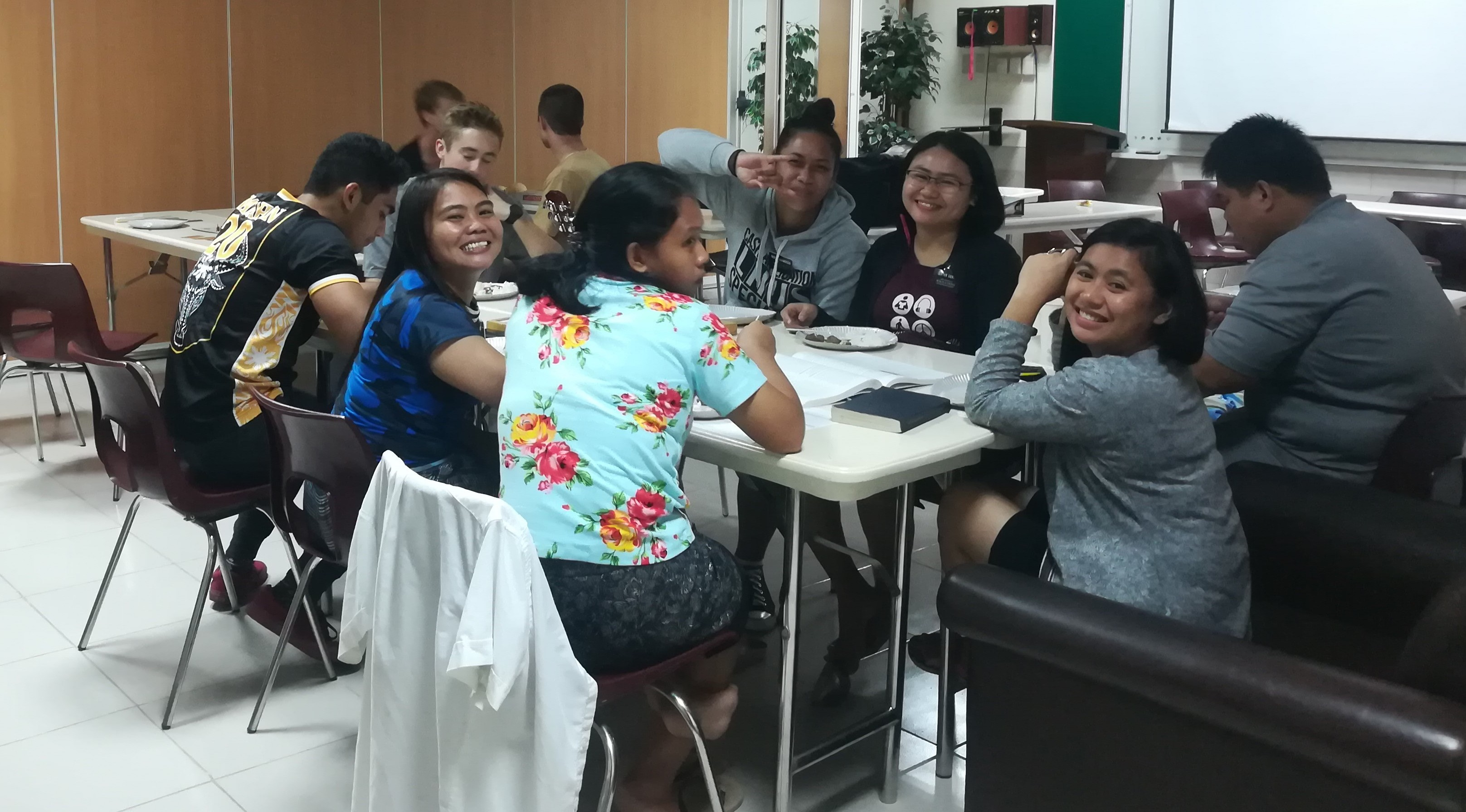Missionaries in the Philippines enjoy time together while sheltered in a meetinghouse during Typhoon Mangkhut.