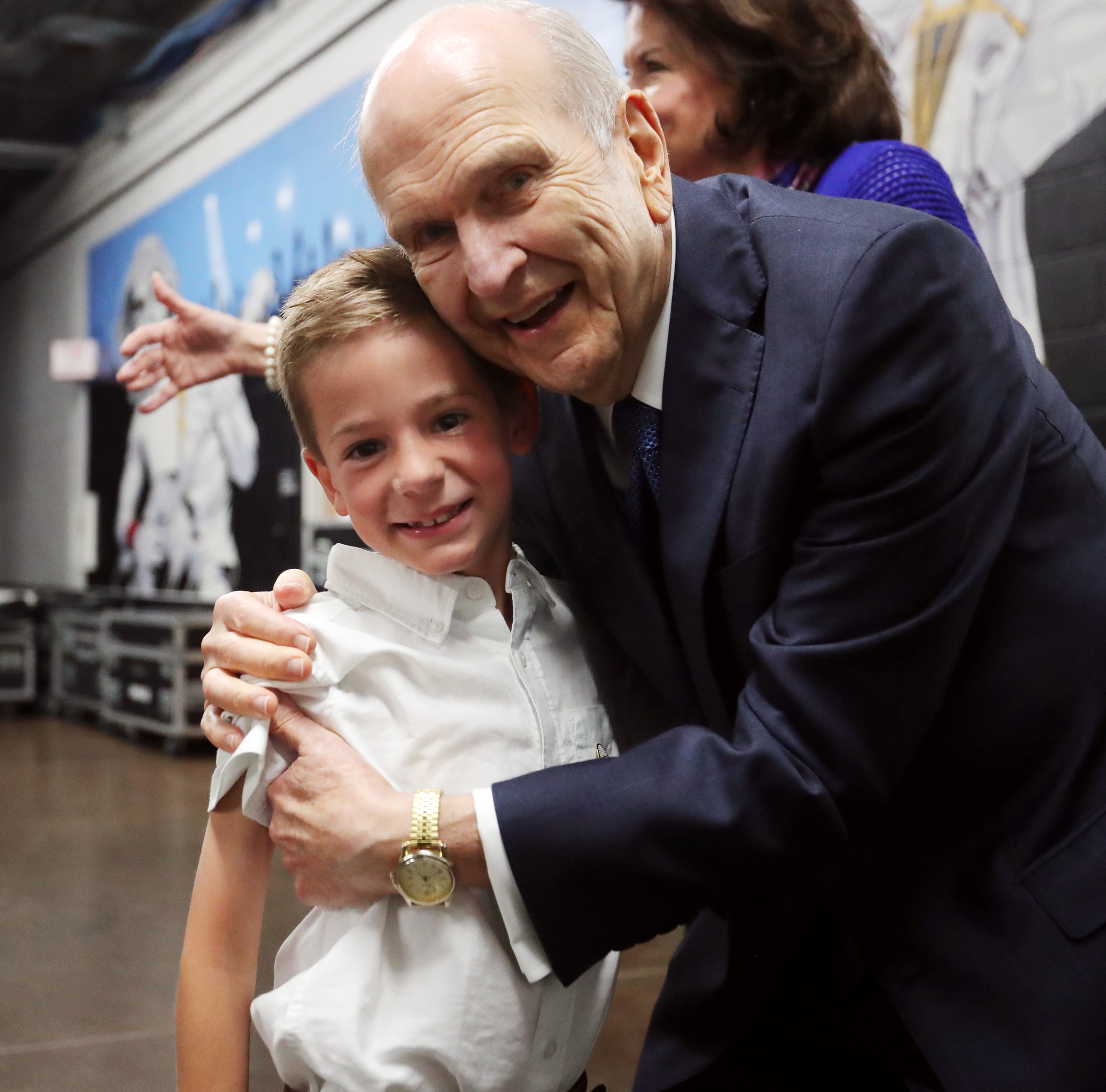 President Russell M. Nelson hugs his great grandson Eli Webster prior to a devotional at the Amway Center in Orlando, Florida, on Sunday, June 9, 2019.