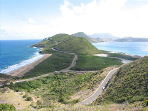 South end of St. Kitts, with the Atlantic Ocean on the left and the Caribbean Sea on the right. Island of Nevis in background. Photo by Greg Hill.