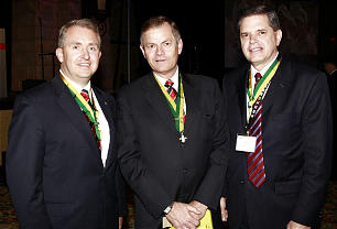 Bishop Gary E. Stevenson, center, the Church's Presiding Bishop, is joined at the May 23 Duty to God Breakfast by event chairman Brother Paul L. Moffat, left, and Brother David L. Beck, Young Men general president.