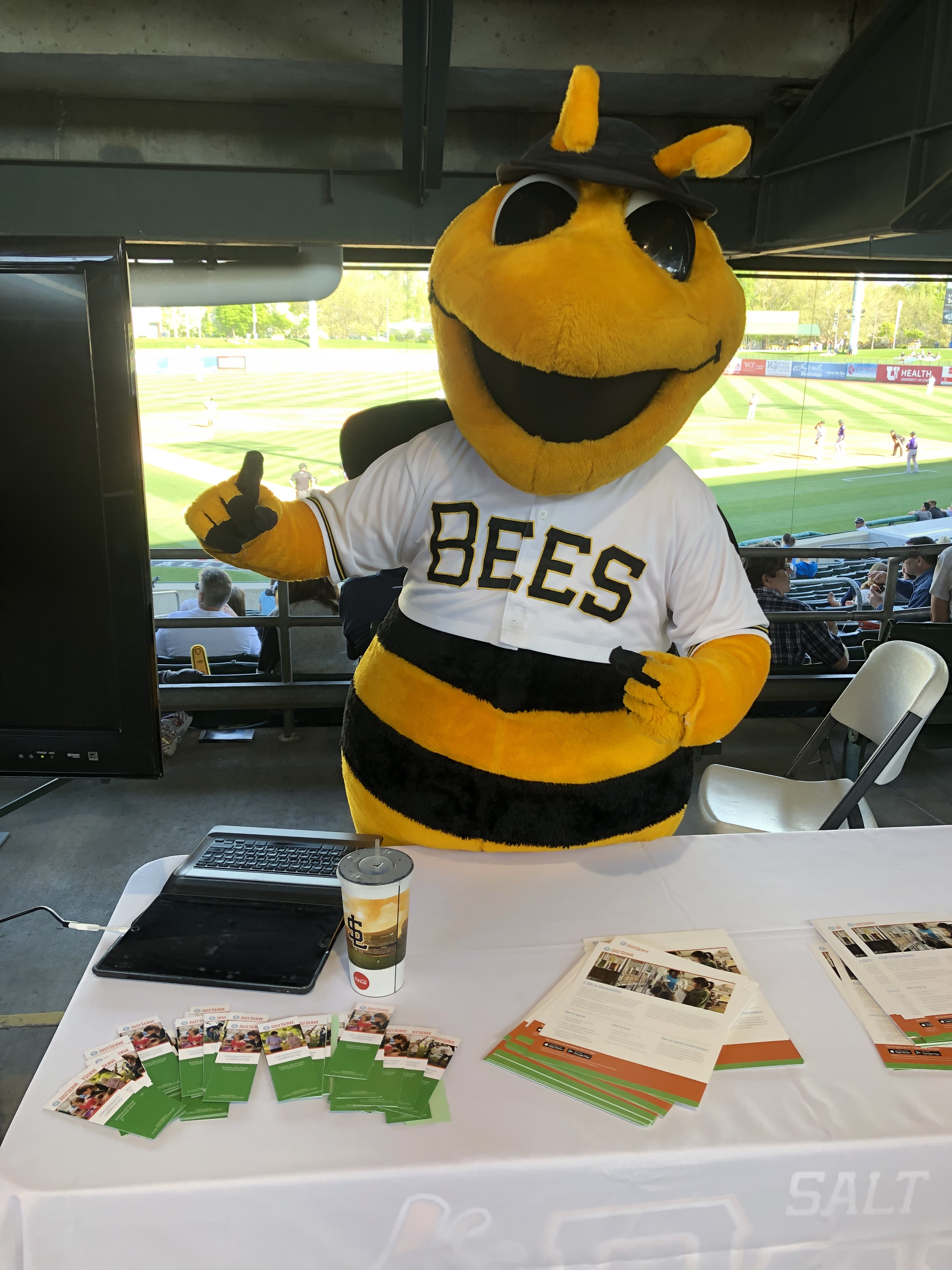 The Salt Lake Bees mascot helps at the JustServe information table at the Bees game on April 27.