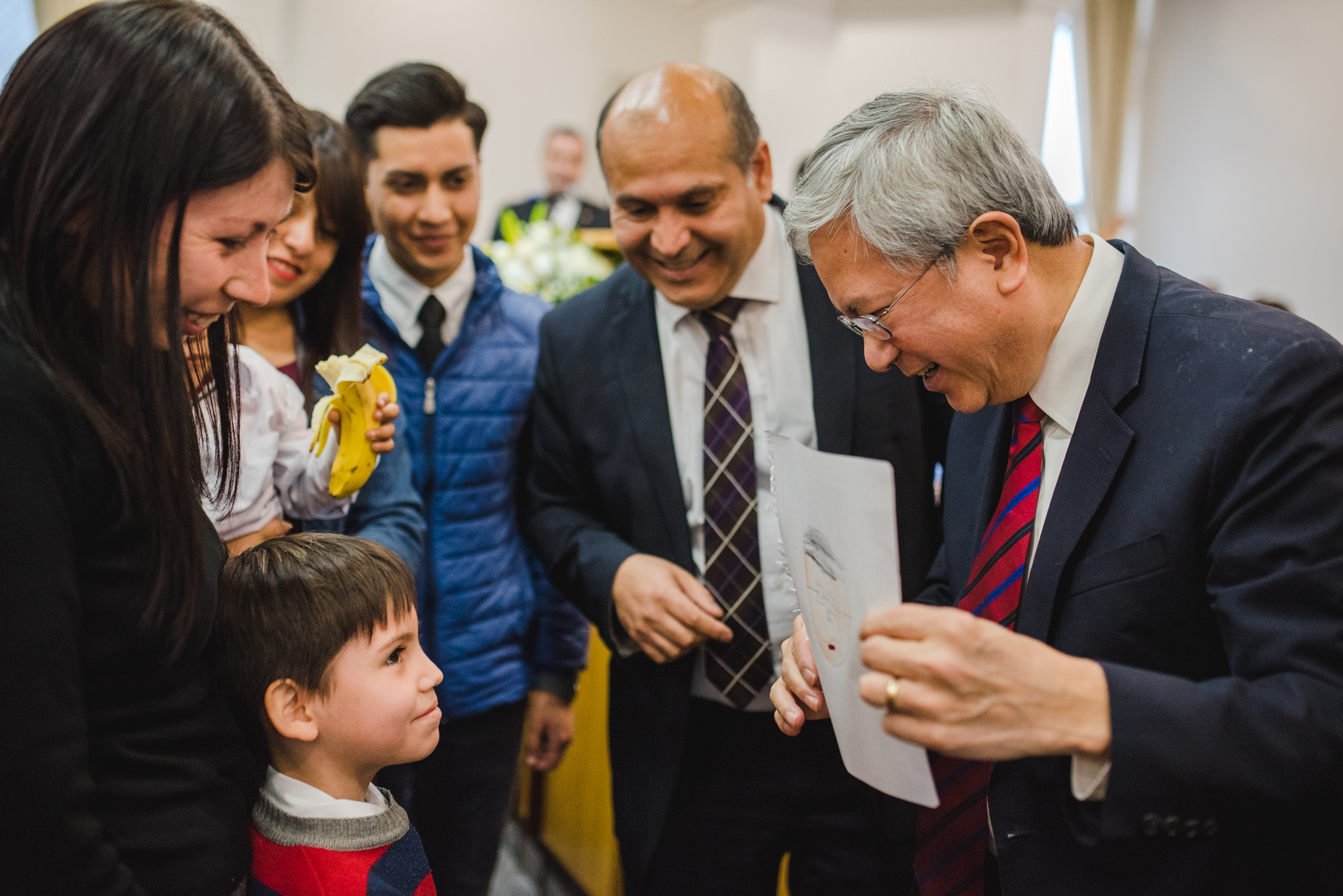 Elder Gong speaks with members following stake conference in the Santiago Chile El Bosque Stake on Nov. 11.