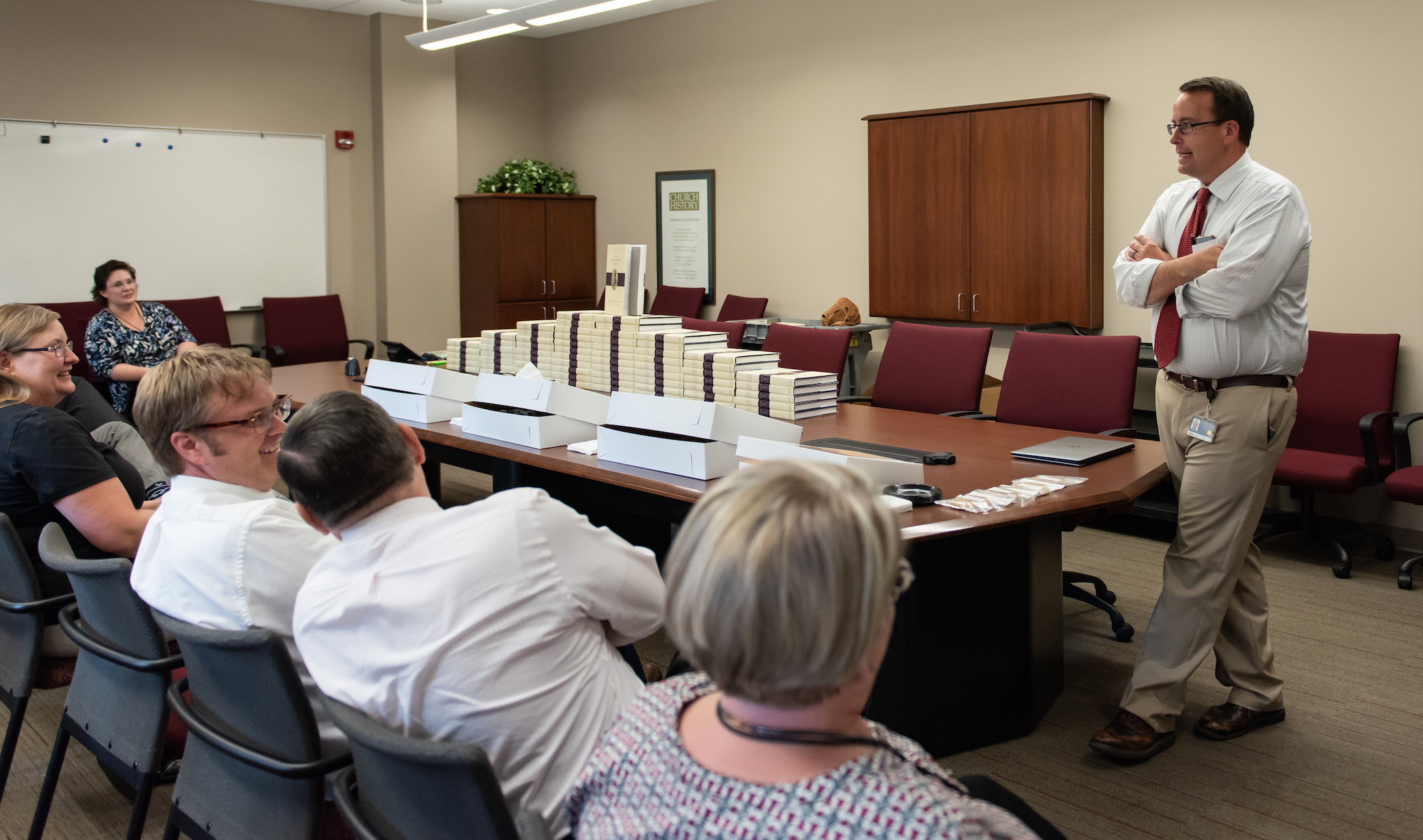 Robin S. Jensen, an associate managing historian for the Joseph Smith Papers and volume editor, speaks to staff members at an event celebrating the release of a new volume.