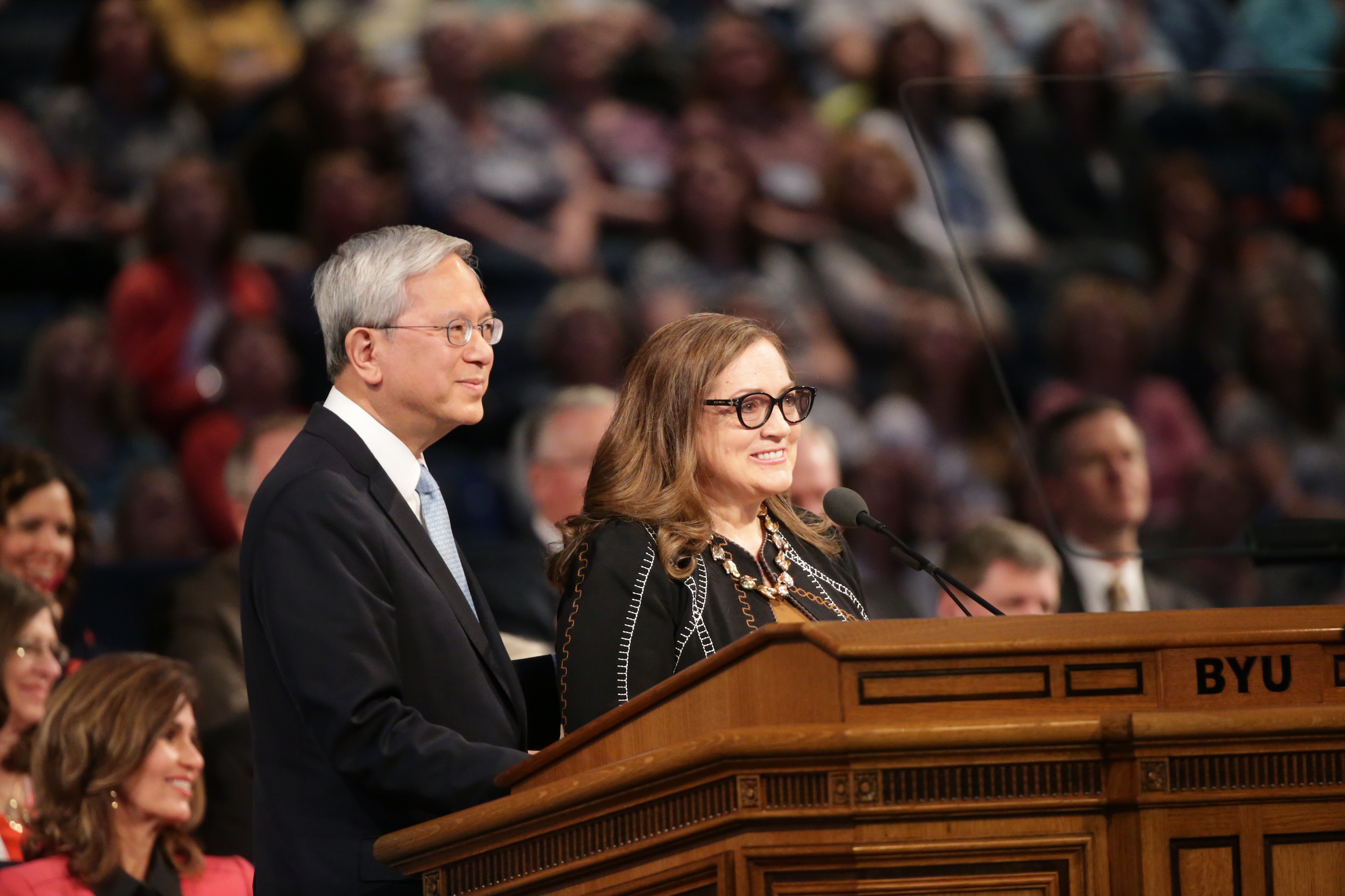 Elder Gerrit W. Gong and his wife, Sister Susan L. Gong, speak at the closing session of BYU's Women's Conference.