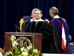The recipient of an honorary doctorate, Elder Jeffrey R. Holland is hooded by Snow College President Scott L. Wyatt, right, and Eddie Cox, chairman of the school's board of trustees. Elder Holland was the commencement speaker.