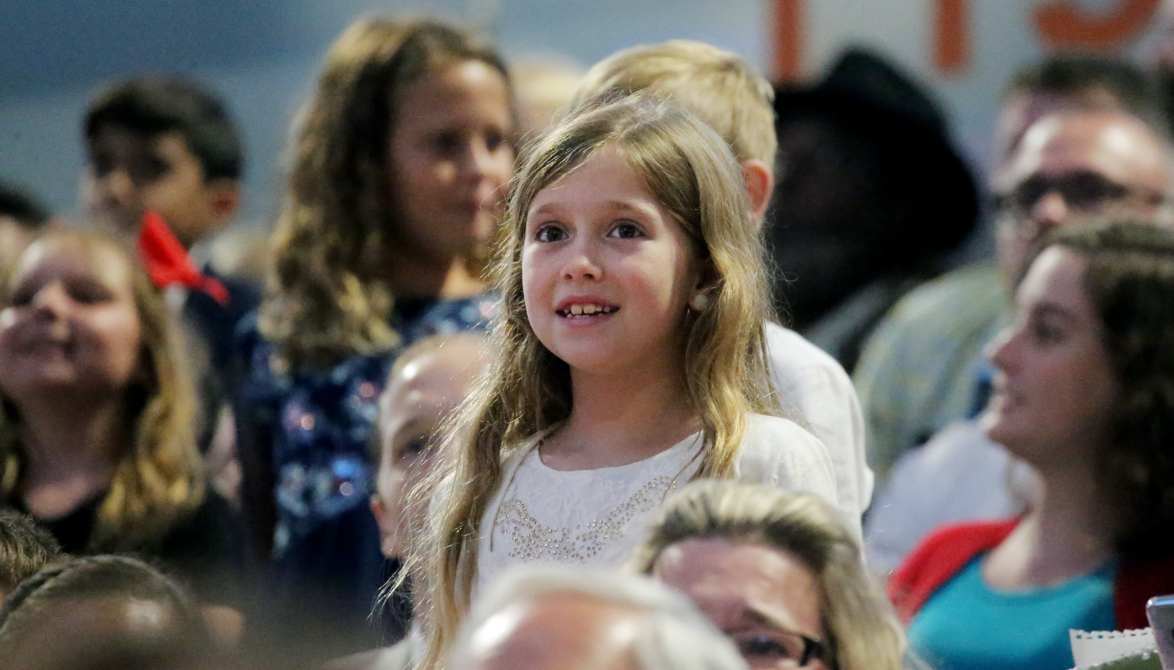 "Giulianna Paternes joins other children in singing the Primary song ""I Am a Child of God"" after President Russell M. Nelson asked them to stand and sing at the Amway Center in Orlando, Florida, in a devotional on Sunday, June 9, 2019."