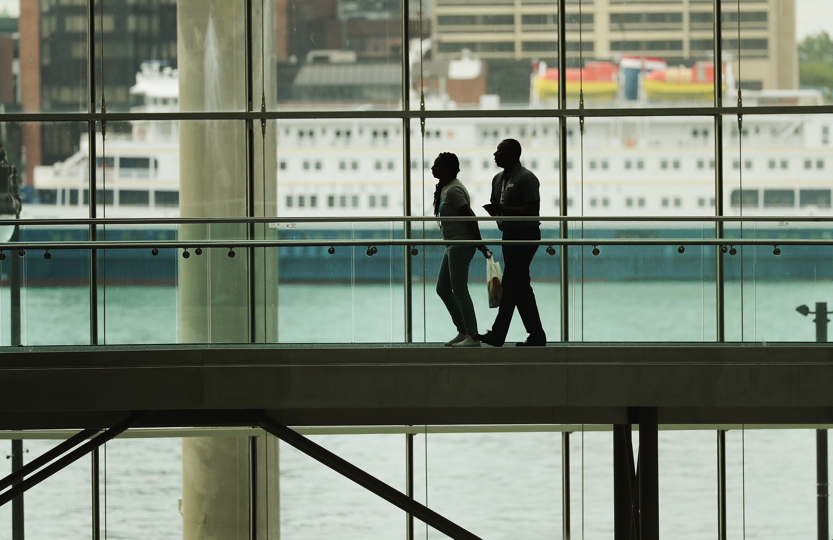 Attendees walk through the COBO convention center with a view of Canada across the Detroit River in Detroit, Michigan, on Sunday, July 21, 2019. The National Association for the Advancement of Colored People is holding its convention at the center.
