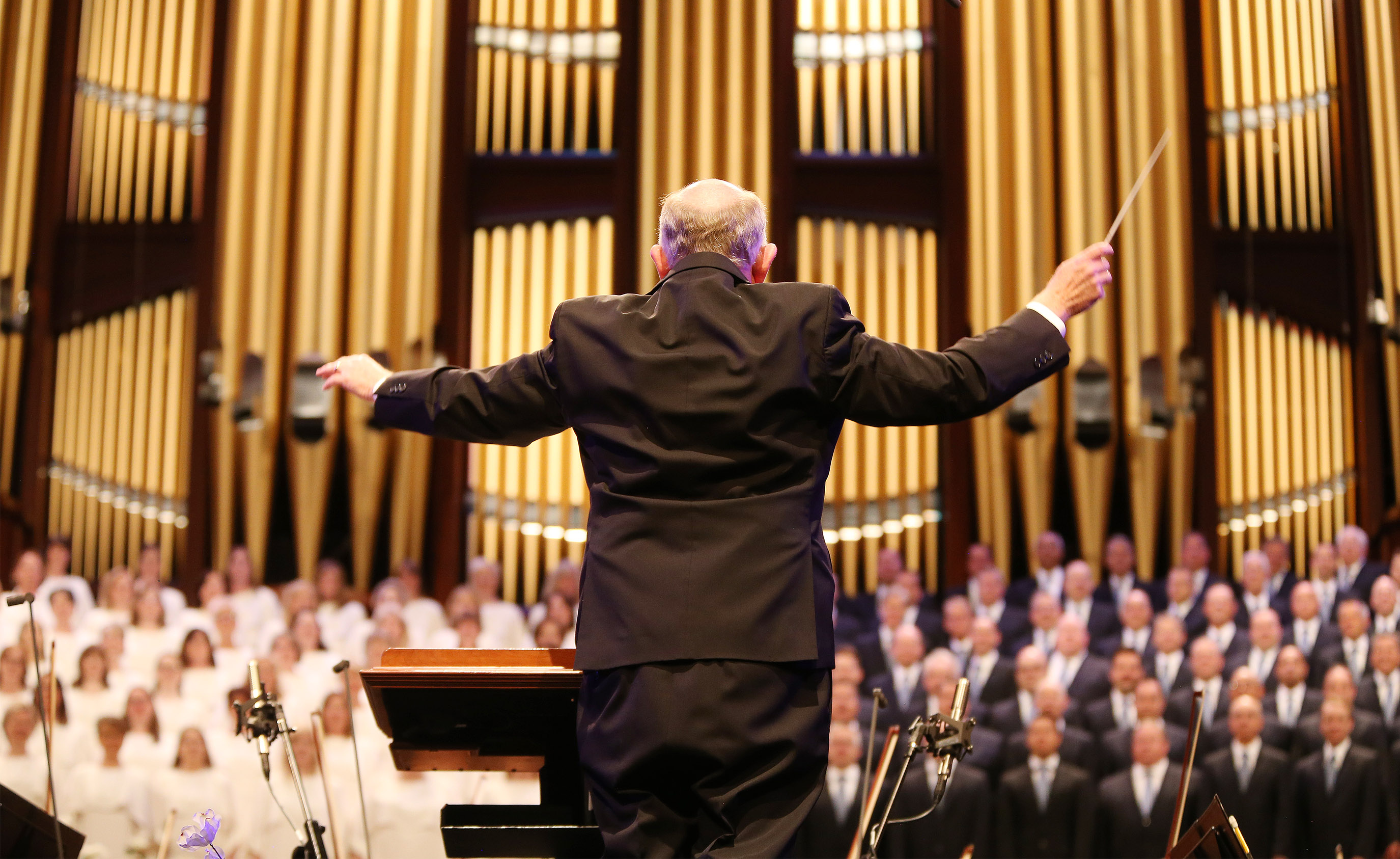 "Conductor Mack Wilberg works with the Tabernacle Choir at Temple Square in Salt Lake City on Sunday, July 14, 2019, during a rehearsal for the 90th anniversary of ""Music and the Spoken Word."" The broadcast originally began in 1929, making ""Music and the Spoken Word"" the longest running continuously broadcast network program in the United States."