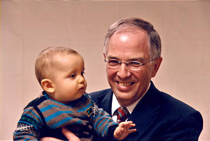 Elder Neil L. Andersen holds Neil Monclair, the son of one of the missionaries who served in Bordeaux, France, under the direction of Elder Andersen.