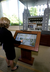 Emily Reynolds looks over an exhibit of a 1:32 scale replica of the Salt Lake Temple in the South Visitors Center on Temple Square.