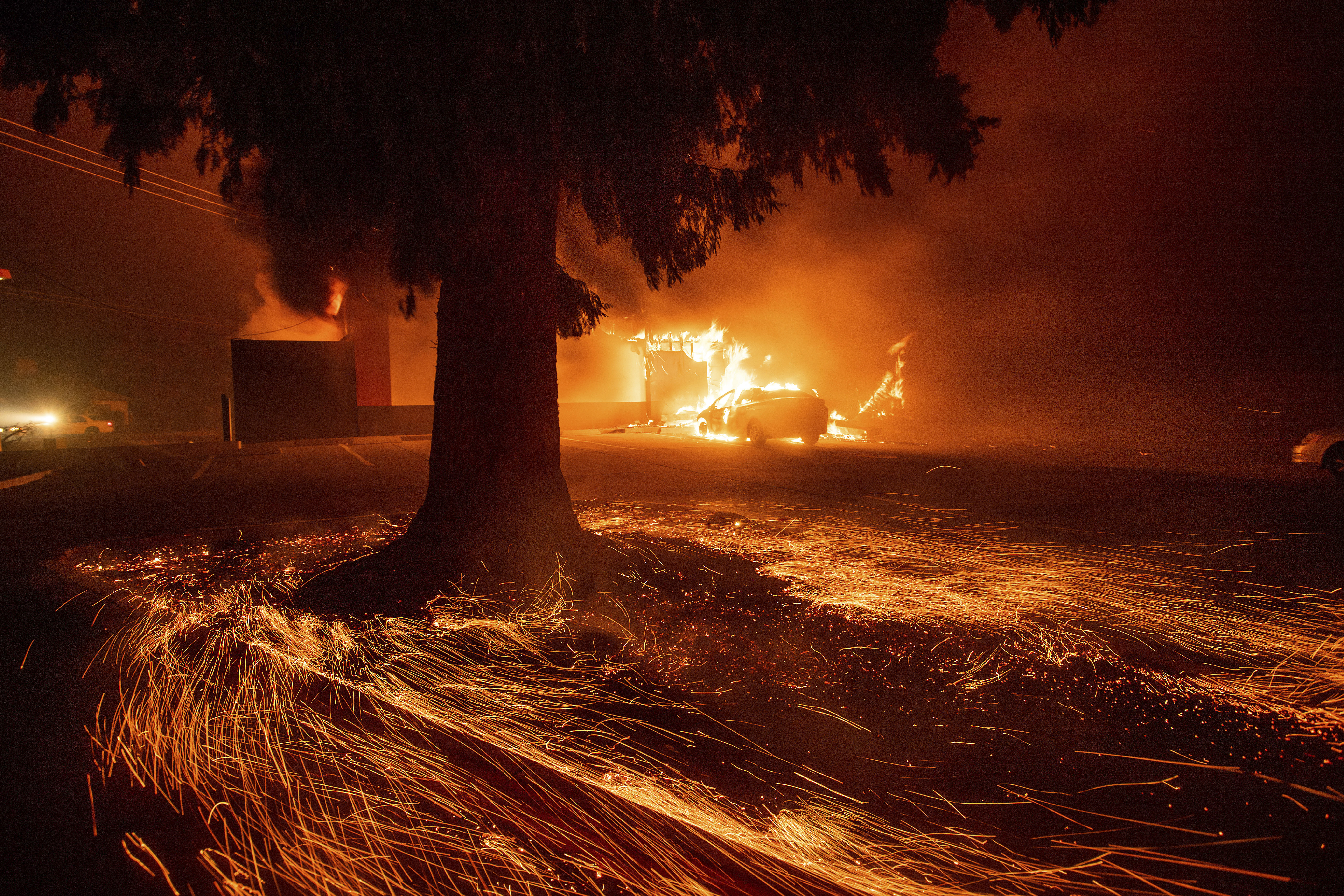 Flames consume a Kentucky Fried Chicken as the Camp Fire tears through Paradise, Calif., on Thursday, Nov. 8, 2018. Tens of thousands of people fled a fast-moving wildfire Thursday in Northern California, some clutching babies and pets as they abandoned vehicles and struck out on foot ahead of the flames that forced the evacuation of an entire town and destroyed hundreds of structures.