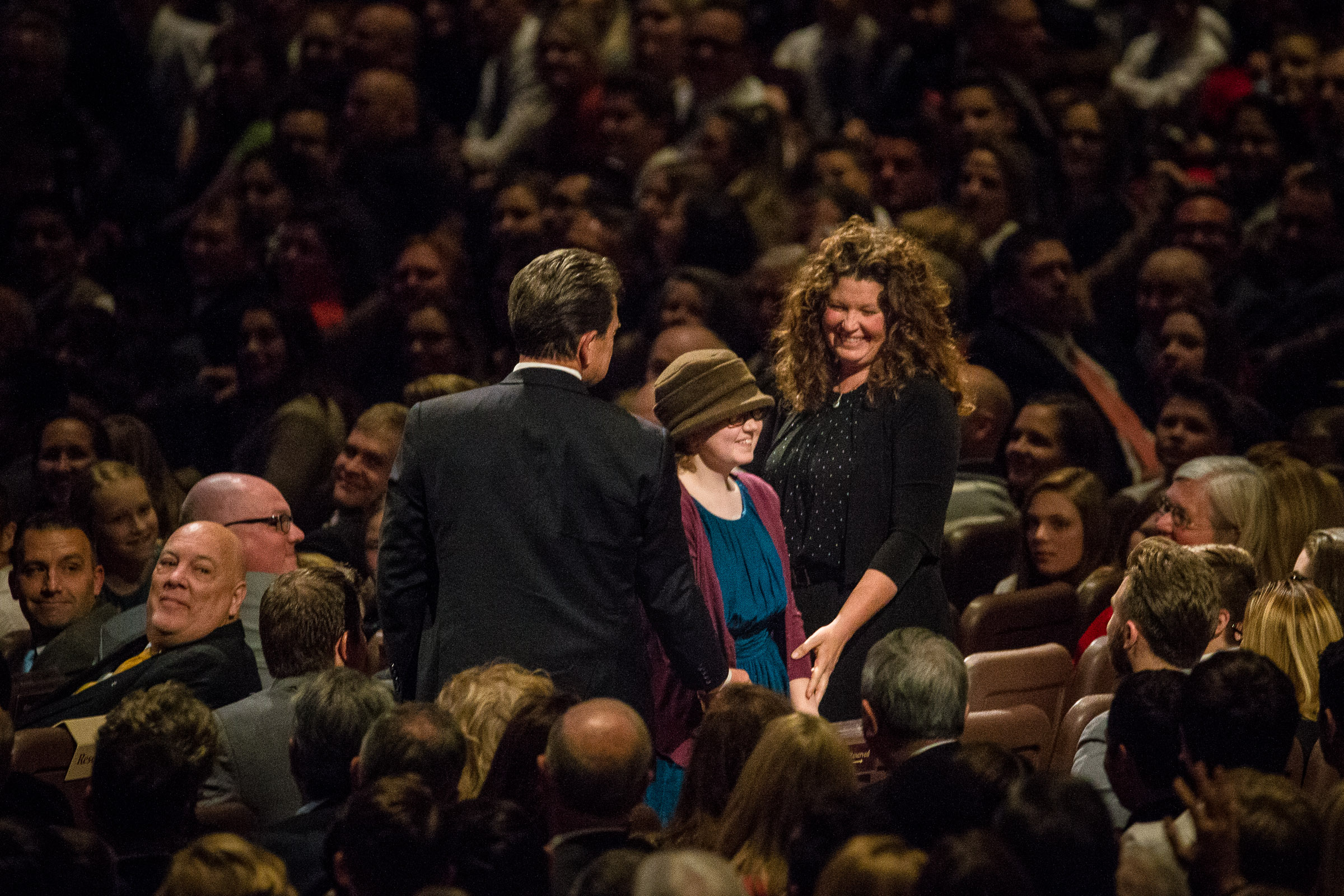 Stephen Terry, left, Lydia Terry, 12, and Kellie Terry stand up and are recognized during President Russell M. Nelson address during the First Presidency's Christmas Devotional at the Conference Center in Salt Lake City on Sunday, Dec. 2, 2018. Lydia, of Bountiful, suffers from a rare, aggressive form of brain cancer.