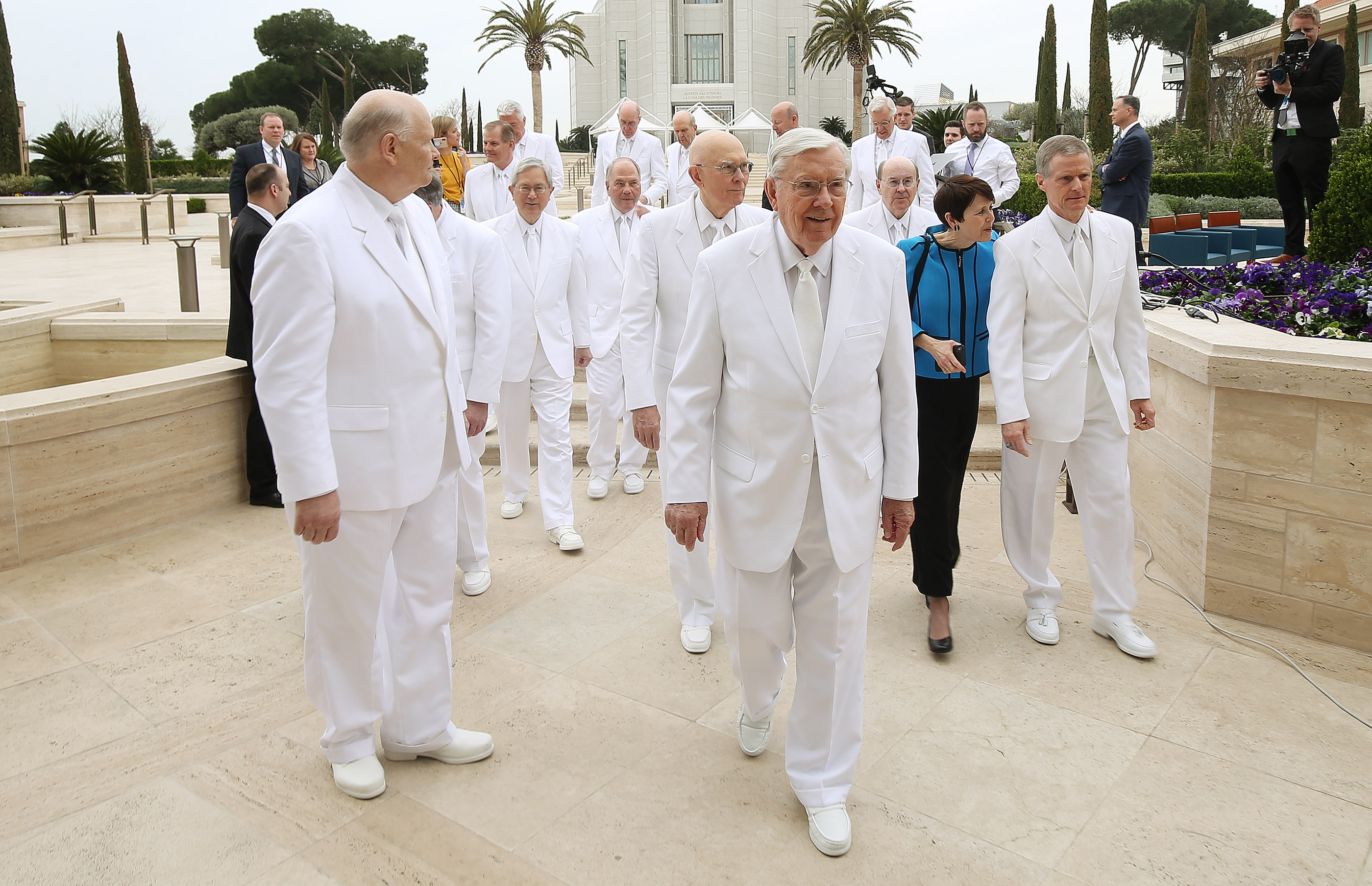 Members of the First Presidency and the Quorum of the Twelve Apostles of The Church of Jesus Christ of Latter-day Saints, walk between photograph locations in the Rome Italy Temple visitors center in Rome, Italy on Monday, March 11, 2019.