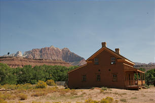 Grafton is situated in southern Utah just west of Zion National Park. Featured is a side view of the Alonzo and Nancy Russell Home juxtaposed against the scenic backdrop of Mt. Kenisava in Zion National Park. Following the death of his father, Alonzo Russell, in 1910, Frank Russell bought the house for $200 and a cow. He stayed in the home until 1945 when he and his wife, Mary Ellen, moved to St. George, leaving Grafton uninhabited.
