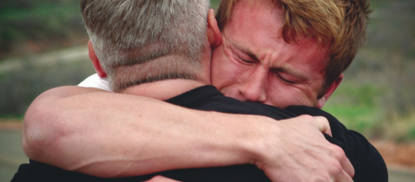 """Landon Henneman as Tyler McMillan in """"Wayward: The Prodigal Son"""" hugs his father Robert McMillan (played by writer/director Rob Diamond) after they are reunited."""