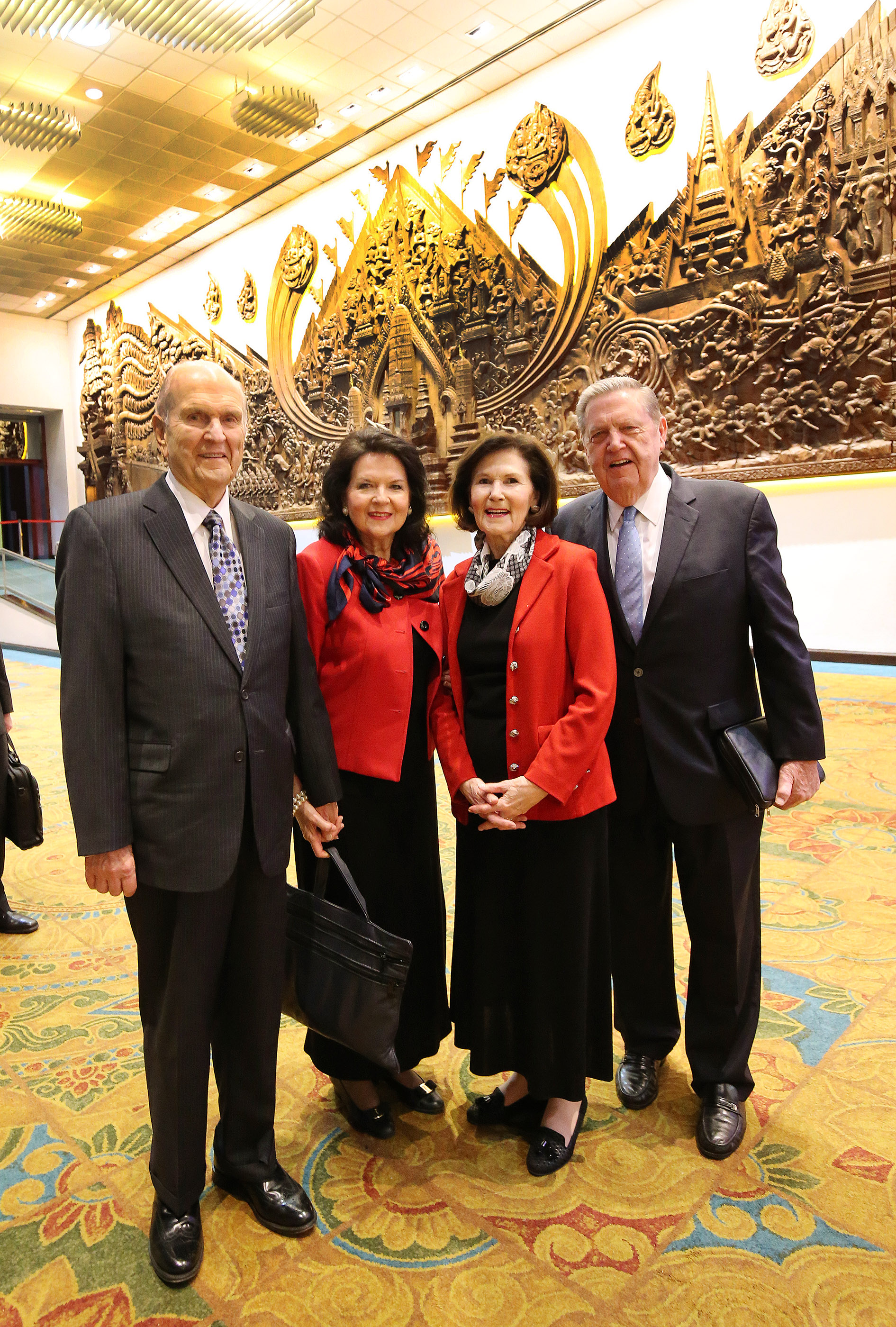 President Russell M. Nelson, his wife, Sister Wendy Nelson, Elder Jeffrey R. Holland of the Quorum of the Twelve Apostles, and Sister Patricia Holland pause before a devotional in Bangkok, Thailand, on Friday, April 20, 2018.