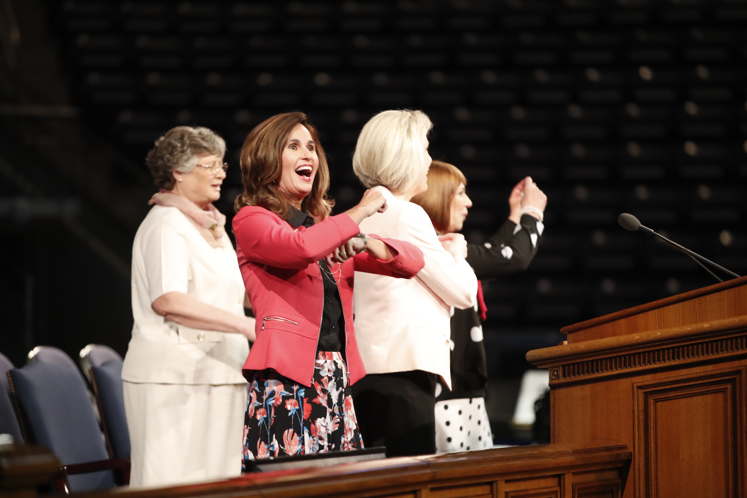 "The Primary general presidency lead the audience in singing ""Do As I'm Doing"" in the Marriott Center at BYU during Women's Conference on May 4."