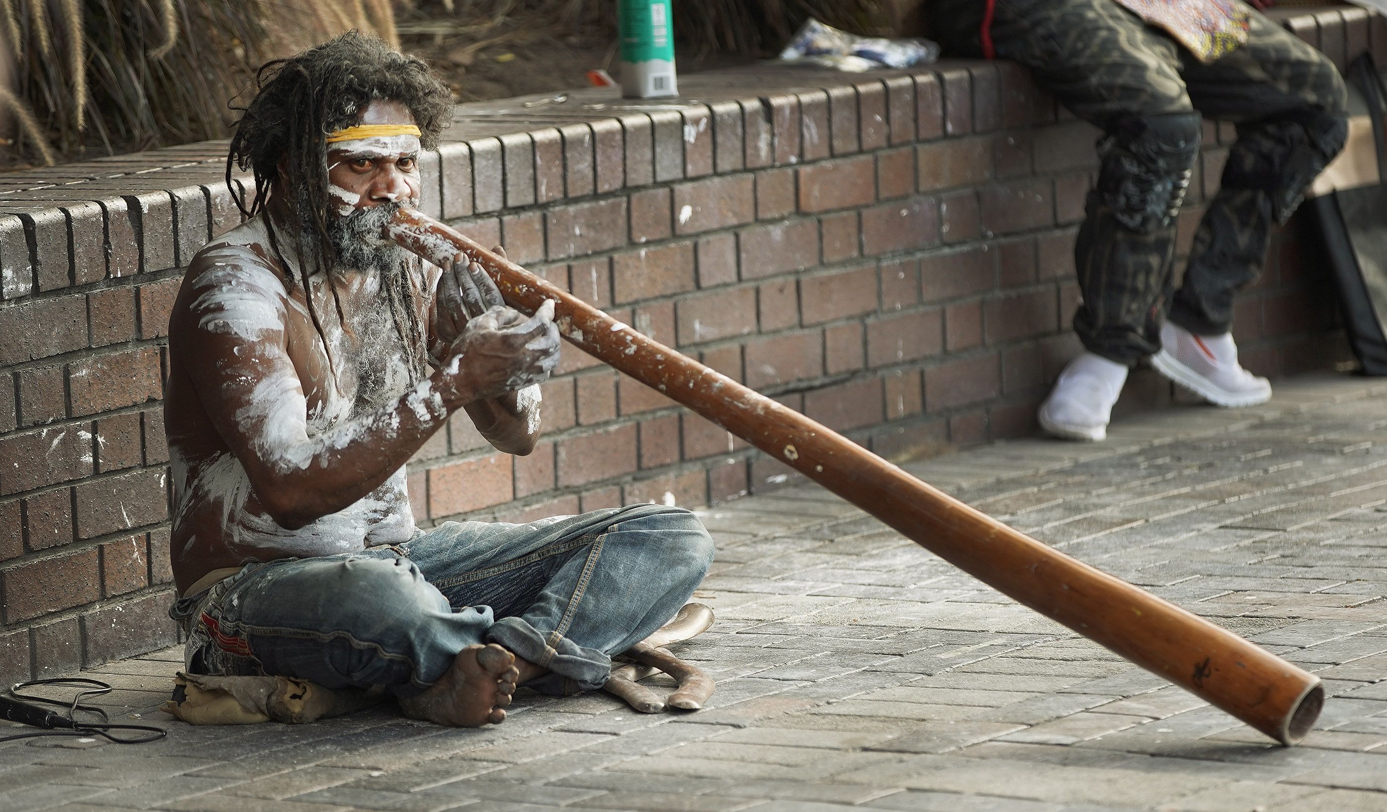An Aboriginal Australian performs on the didgeridoo on the street on May 18, 2019, in Sydney, Australia. President Russell M. Nelson, with his wife, Sister Wendy Nelson, visited the city on his nine-day, seven-nation Pacific Ministry Tour.