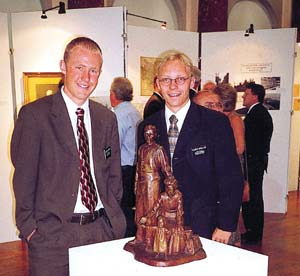 "Elder Jeremy Larsen, left, and Elder Alerander Muller check out the ""European Pioneers"" exhibit in the Hull Maritime Museum."