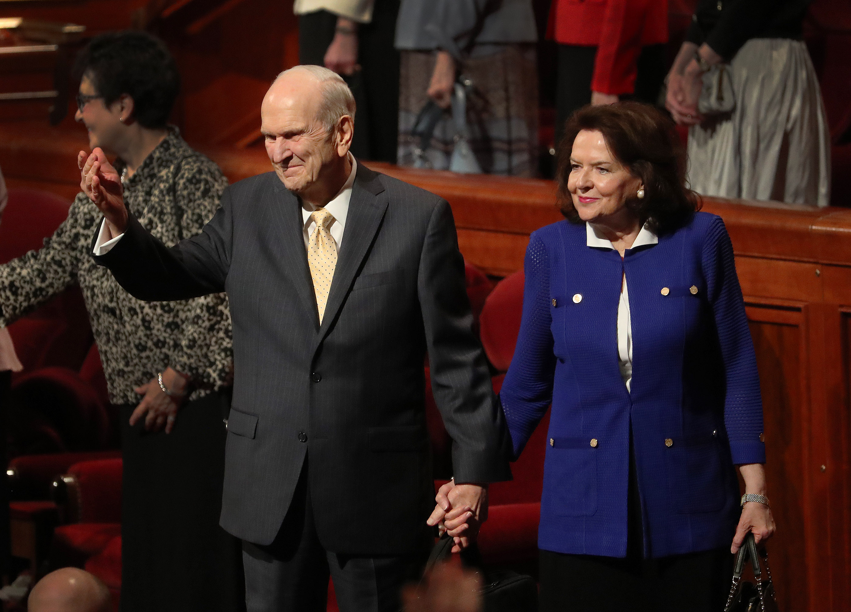 President Russell M. Nelson of The Church of Jesus Christ of Latter-day Saints, and his wife, Sister Wendy Nelson, wave to conferencegoers of the 189th Annual General Conference of The Church of Jesus Christ of Latter-day Saints in Salt Lake City on Saturday, April 6, 2019.