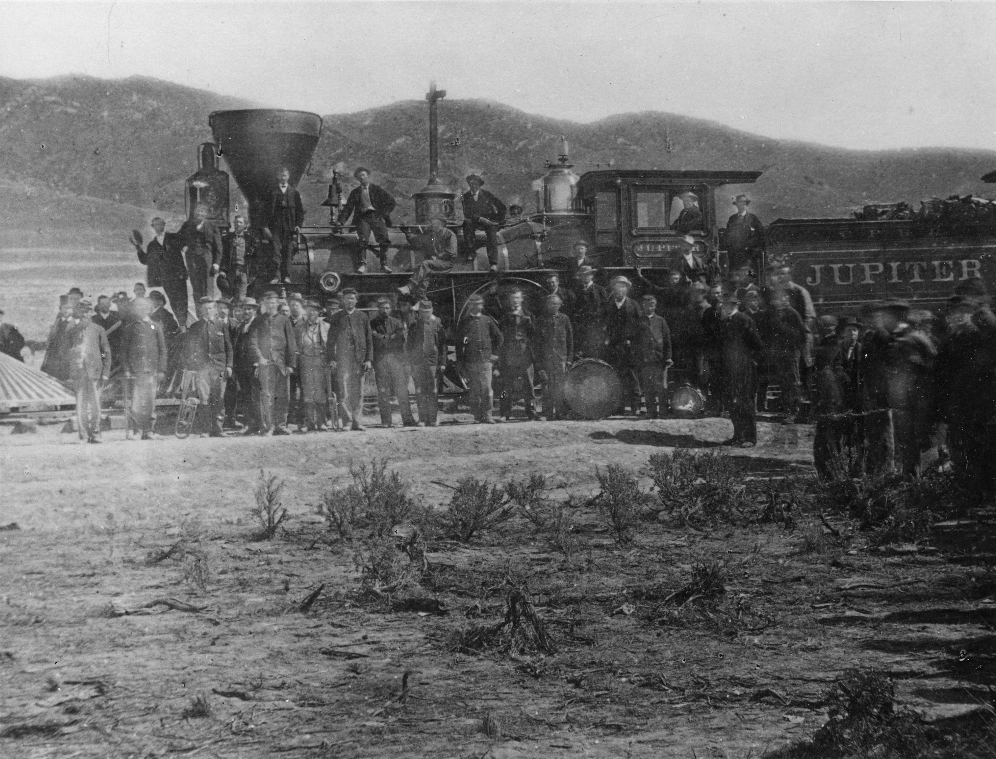 Central Pacific locomotive #60, Jupiter, is photographed at Promontory Summit, May 10, 1869, after the driving of the last spike.