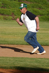 Ralph Olson runs for another base.
