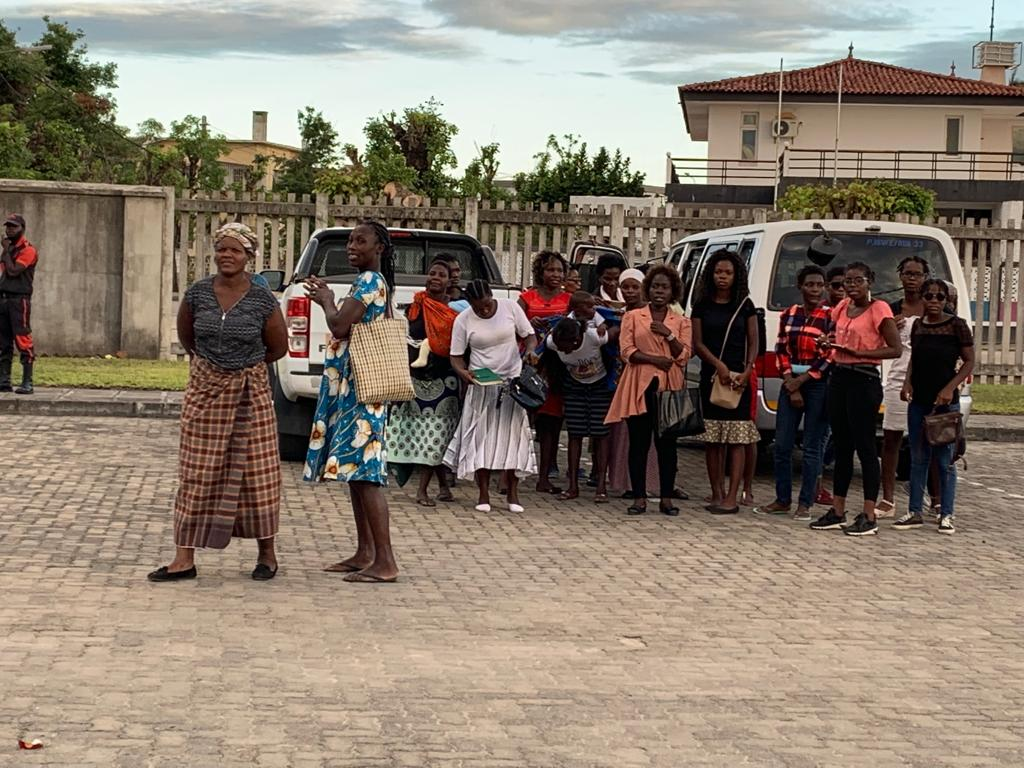 Members in Beira, Mozambique, gather outside a Church meetinghouse during a visit from Sister Bonnie H. Cordon in May 2019.