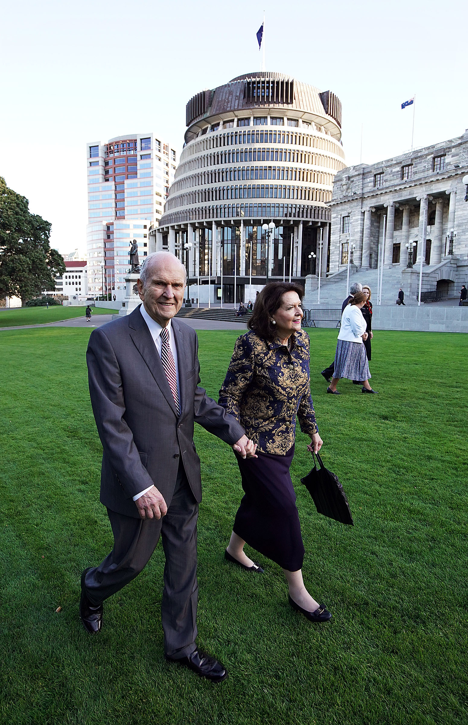 President Russell M. Nelson of The Church of Jesus Christ of Latter-day Saints and his wife, Sister Wendy Nelson, walk past the New Zealand parliament building after meeting with New Zealand Prime Minister Jacinda Ardern in Wellington on Monday, May 20, 2019.