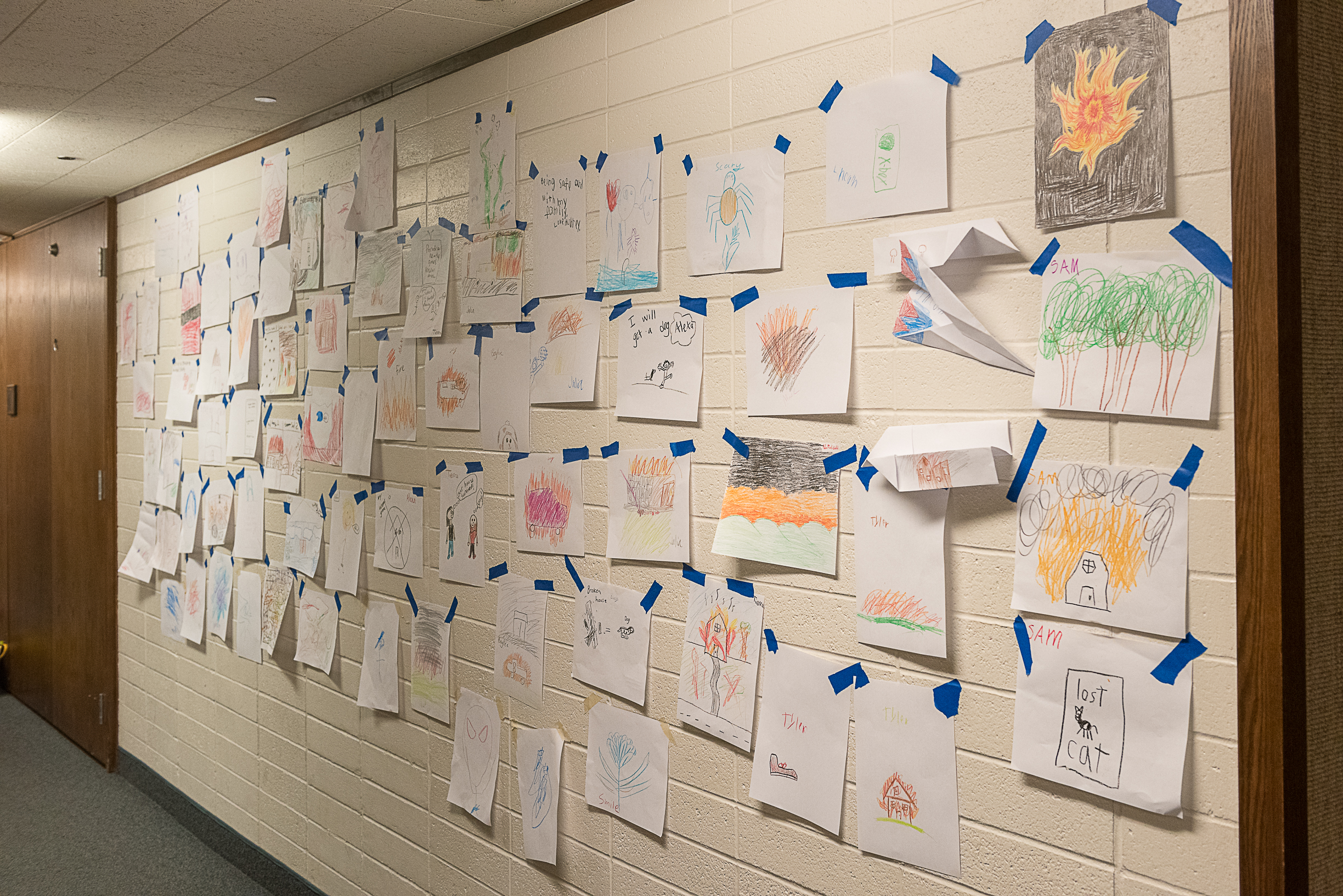 To help face and heal from the devastating wildfire that struck Paradise, California, children create drawings depicting the impact of the fire and place them on the wall of a local meetinghouse, displayed on Nov. 16, 2018. The drawings will remain posted in the building for a long time, say local Church leaders.