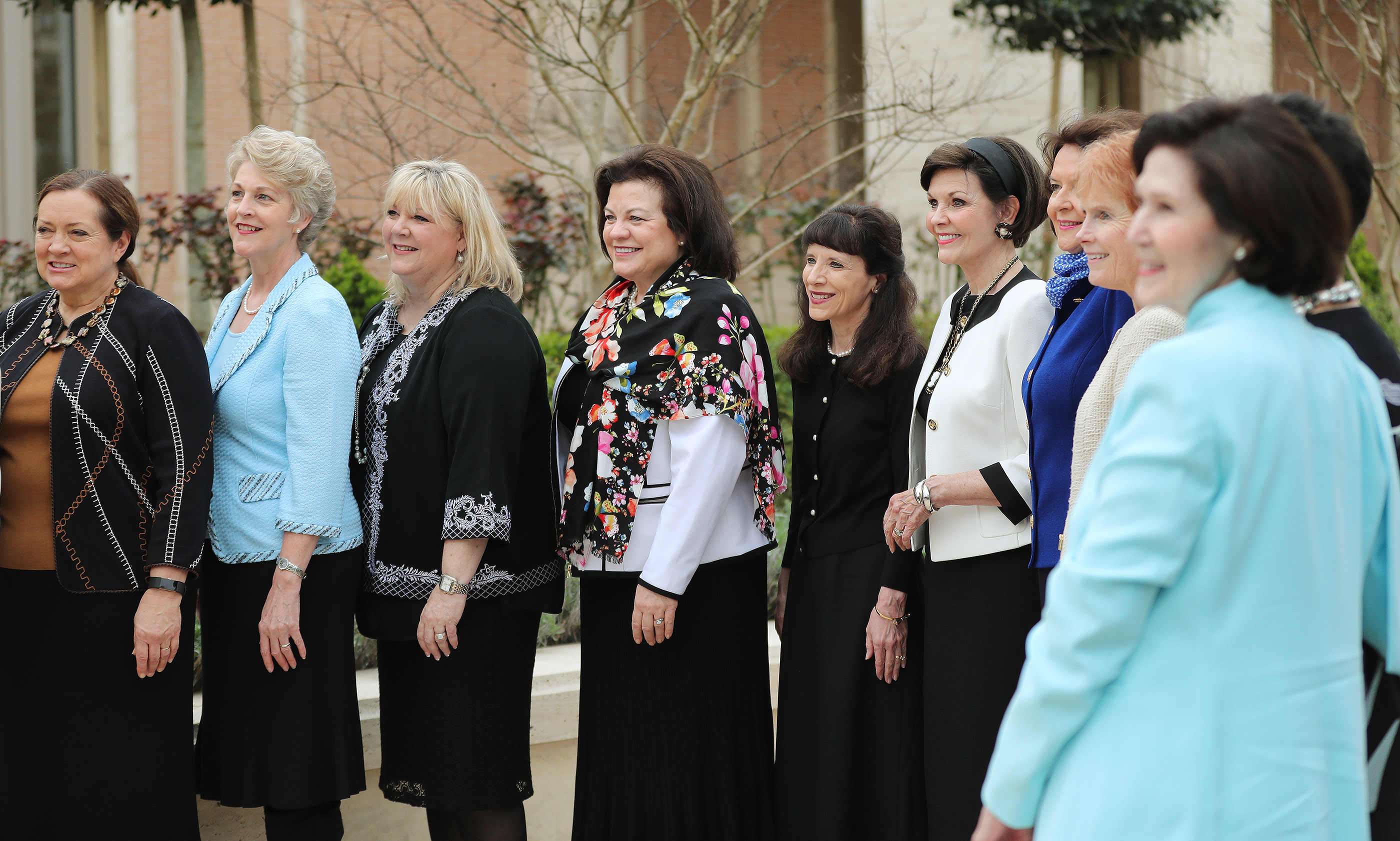Sister Rosana Soares, Sister Susan Gong, Sister Ruth Renlund, Sister Lesa Stevenson, Sister Melanie Rasband, Sister Kathy Andersen, Sister Kristen Oaks, Sister Wendy Nelson, Sister Kathy Christofferson, Sister Mary Cook, Sister Susan Bednar, Sister Harriet Uchtdorf and Sister Patricia Holland pose for a photograph near the Rome Italy Temple visitors' center in Rome, Italy on Monday, March 11, 2019.