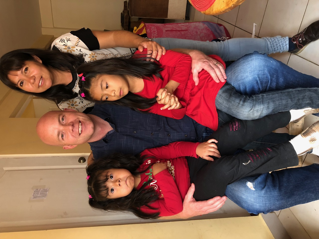 Davis Smith with Giovanna, a member he baptized 20 years ago, and her two daughters on one of his recent return trips to Bolivia.