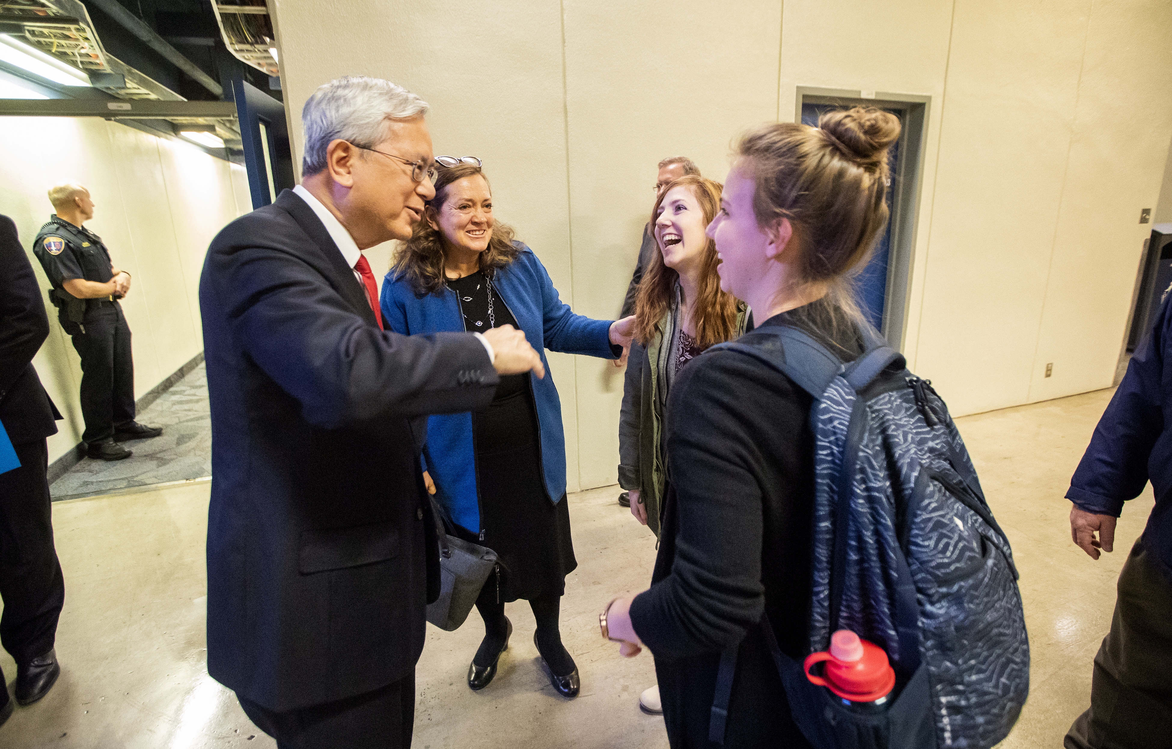 Elder Gerrit W. Gong of the Quorum of the Twelve Apostles and his wife, Sister Susan Gong, speak with Anna Evans and Sophie Richards prior to a BYU campus devotional on Tuesday, Oct. 16, 2018.