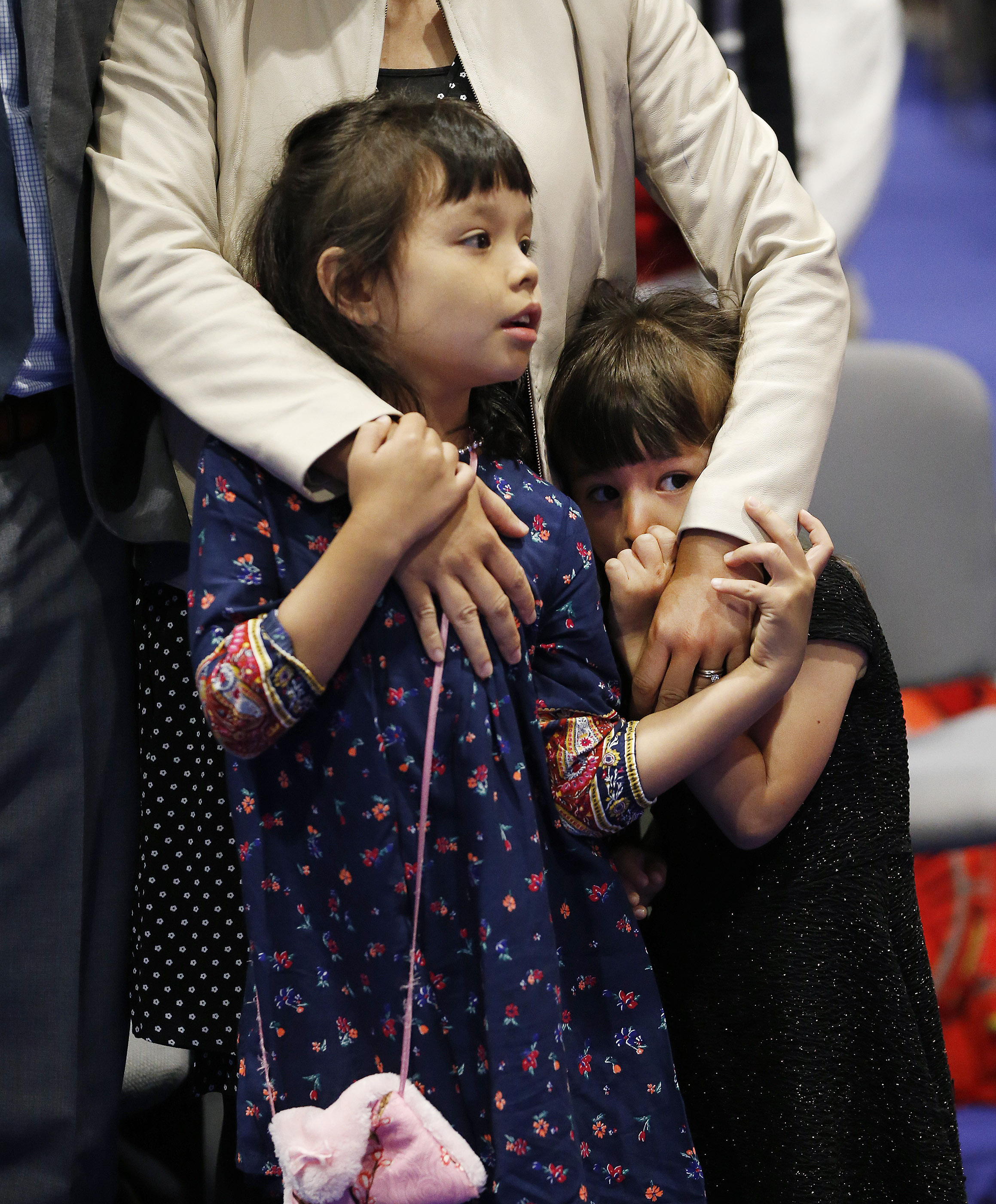 Annabelle and Claire watch as President Russell M. Nelson leaves the stand after a devotional in Hong Kong on Saturday, April 21, 2018.