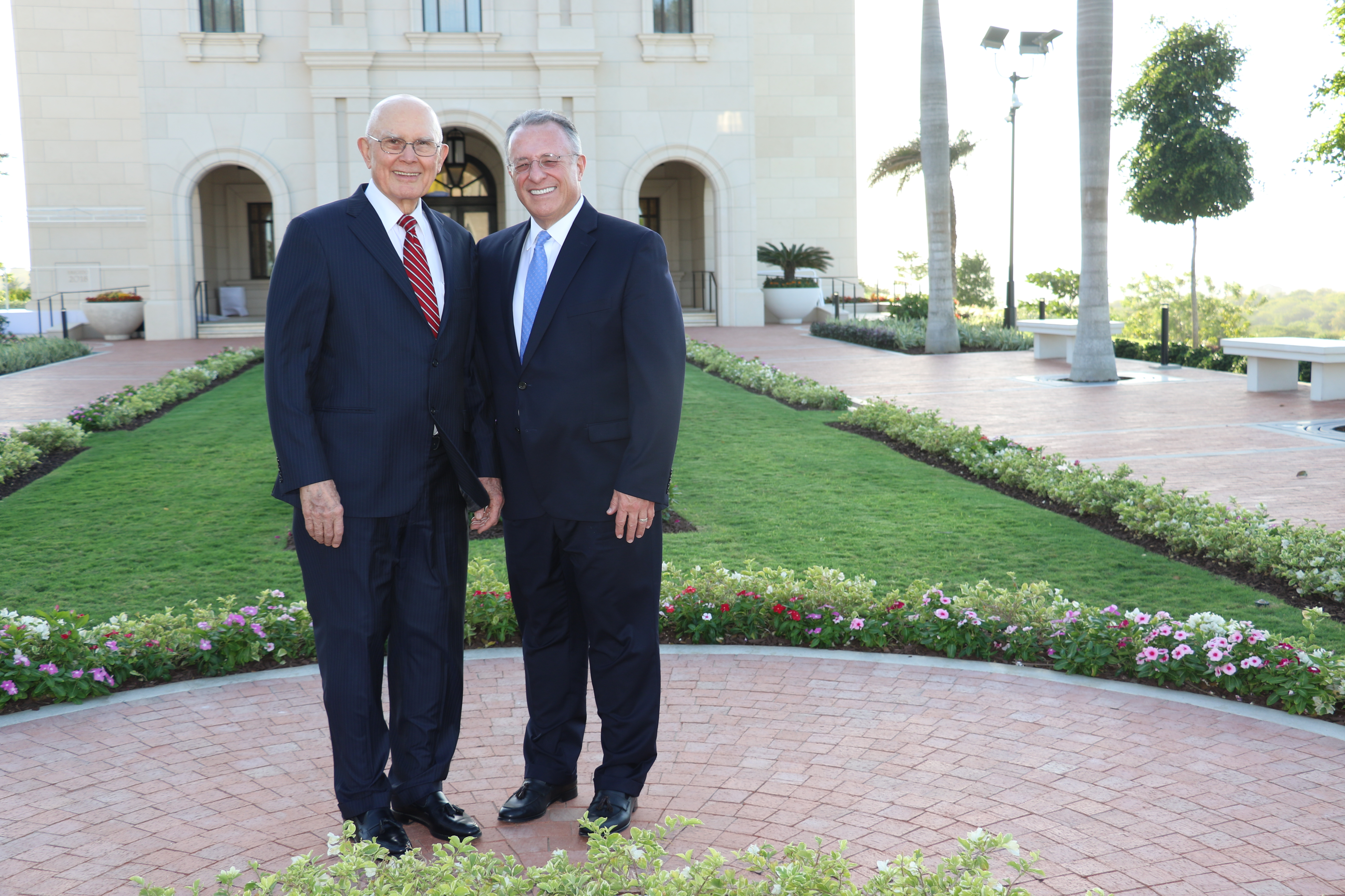 President Dallin H. Oaks of the First Presidency and Elder Ulisses Soares of the Quorum of the Twelve Apostles stand outside the Barranquilla Colombia Temple.