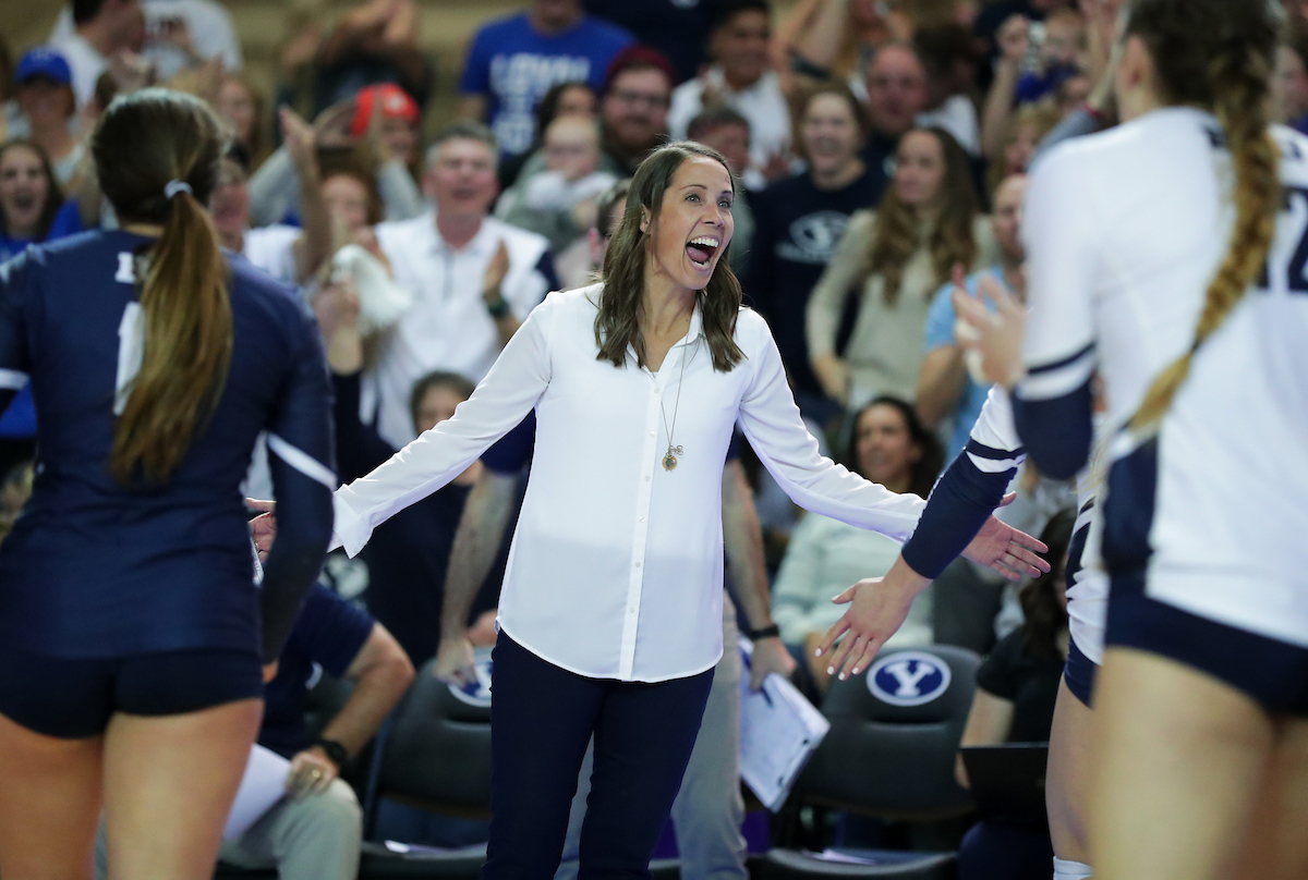 BYU head coach Heather Olmstead celebrates during a third-set timeout in the Cougars' 3-0 victory over Texas in the 2018 NCAA Regional Finals in Provo, Utah, on Dec. 8, 2018.