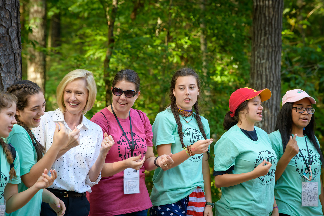 Sister Bonnie H. Cordon, Young Women general president, sings a song with young women at Heber Valley Girls Camp.