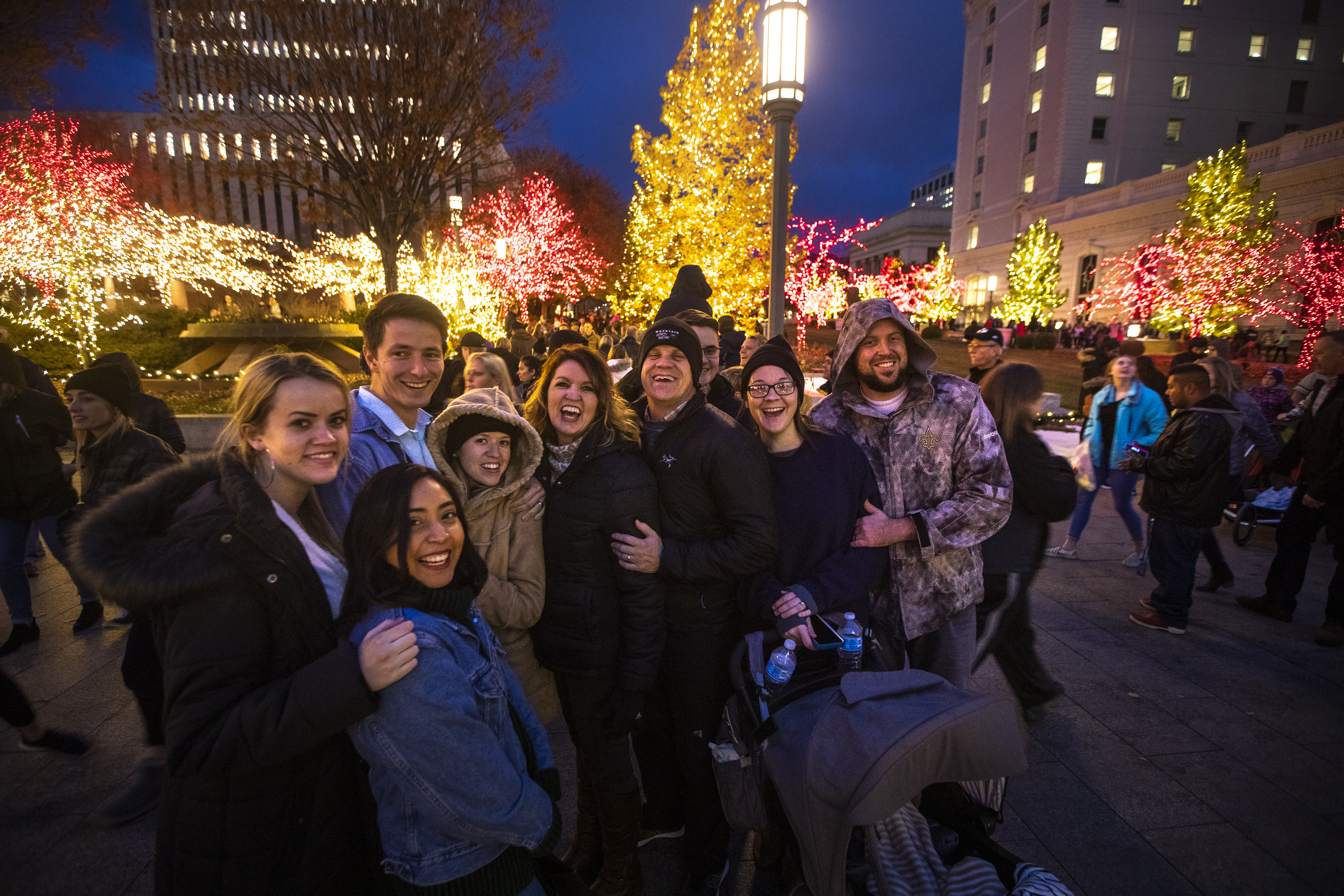 The Whipple family, from Houston Texas, laugh as they pose for a photo with the lights around them at Temple Square in Salt Lake City on Friday, Nov. 23, 2018.