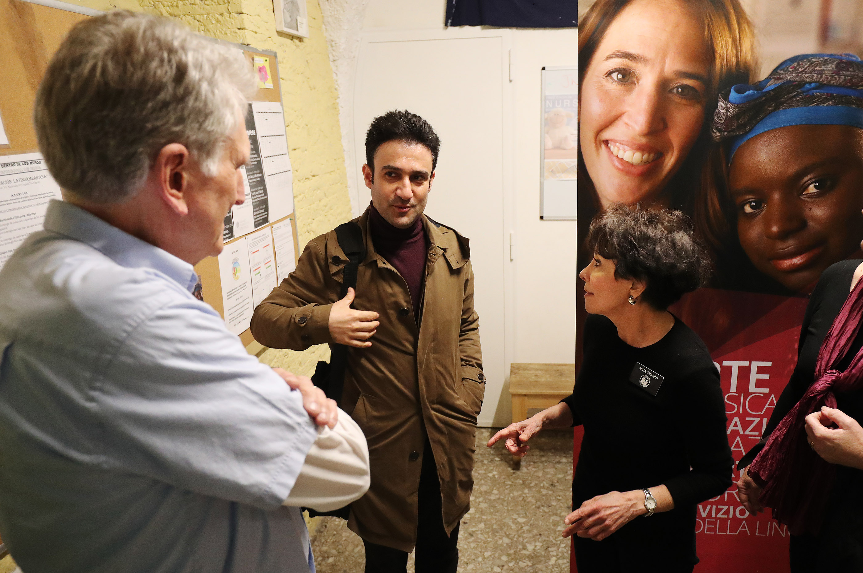 Latter-day Saint Charities missionaries Steve and Anita Canfield talk with Iraqi refugee Imad Mosa at St. Paul's Within the Walls Episcopal Church in Rome, Italy on Thursday, March 7, 2019. The Church of Jesus Christ of Latter-day Saints partners with the Catholic church to help refugees.