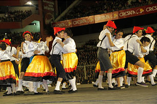 Young performer in German clothing perform folk dance at Sept. 8, 2012, LDS Argentina cultural celebration.