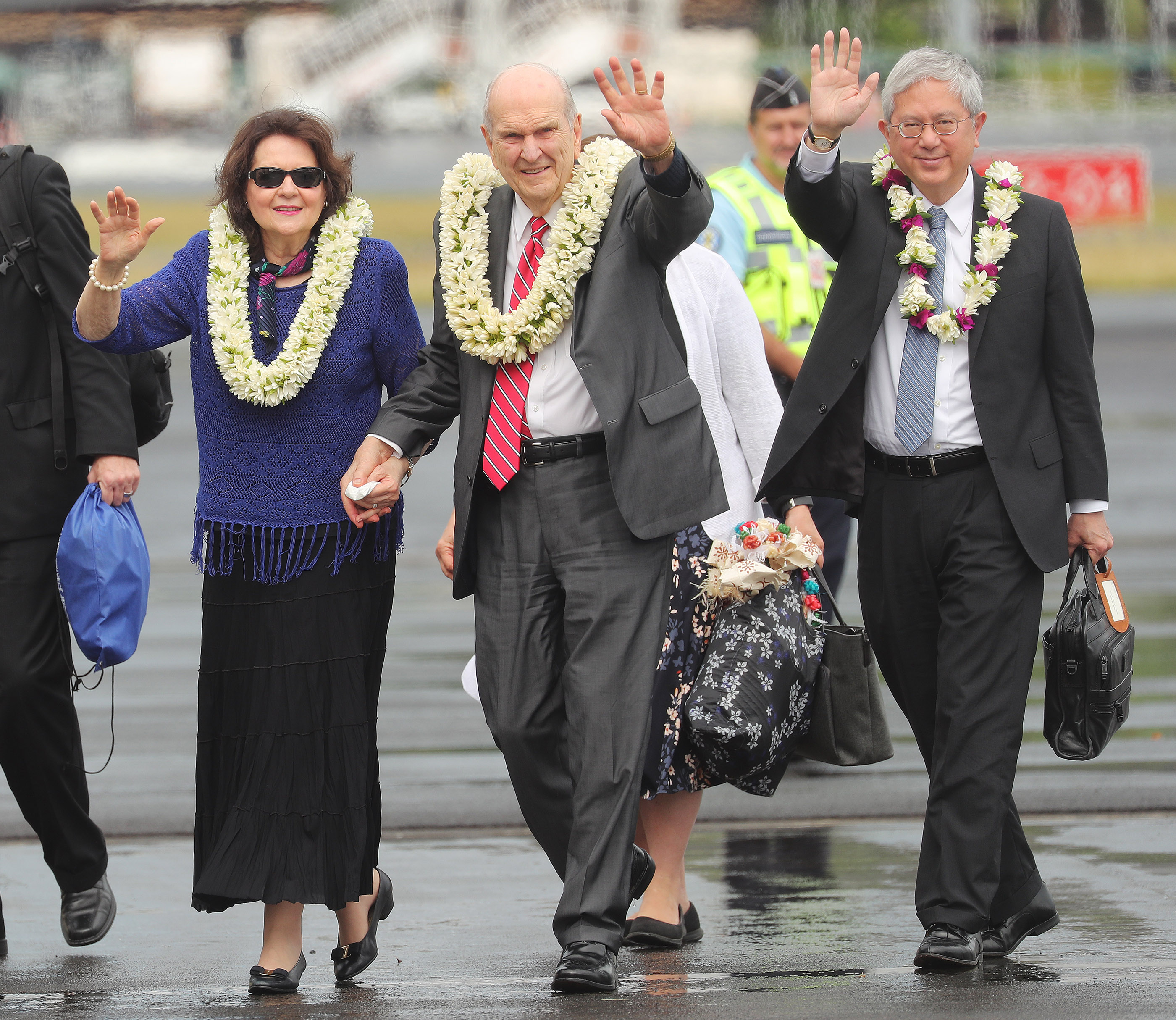 President Russell M. Nelson of The Church of Jesus Christ of Latter-day Saints and his wife, Sister Wendy Nelson, and Elder Gerrit W. Gong of the Quorum of the Twelve Apostles, wave upon arrival in Papeete, Tahiti, on May 23, 2019.