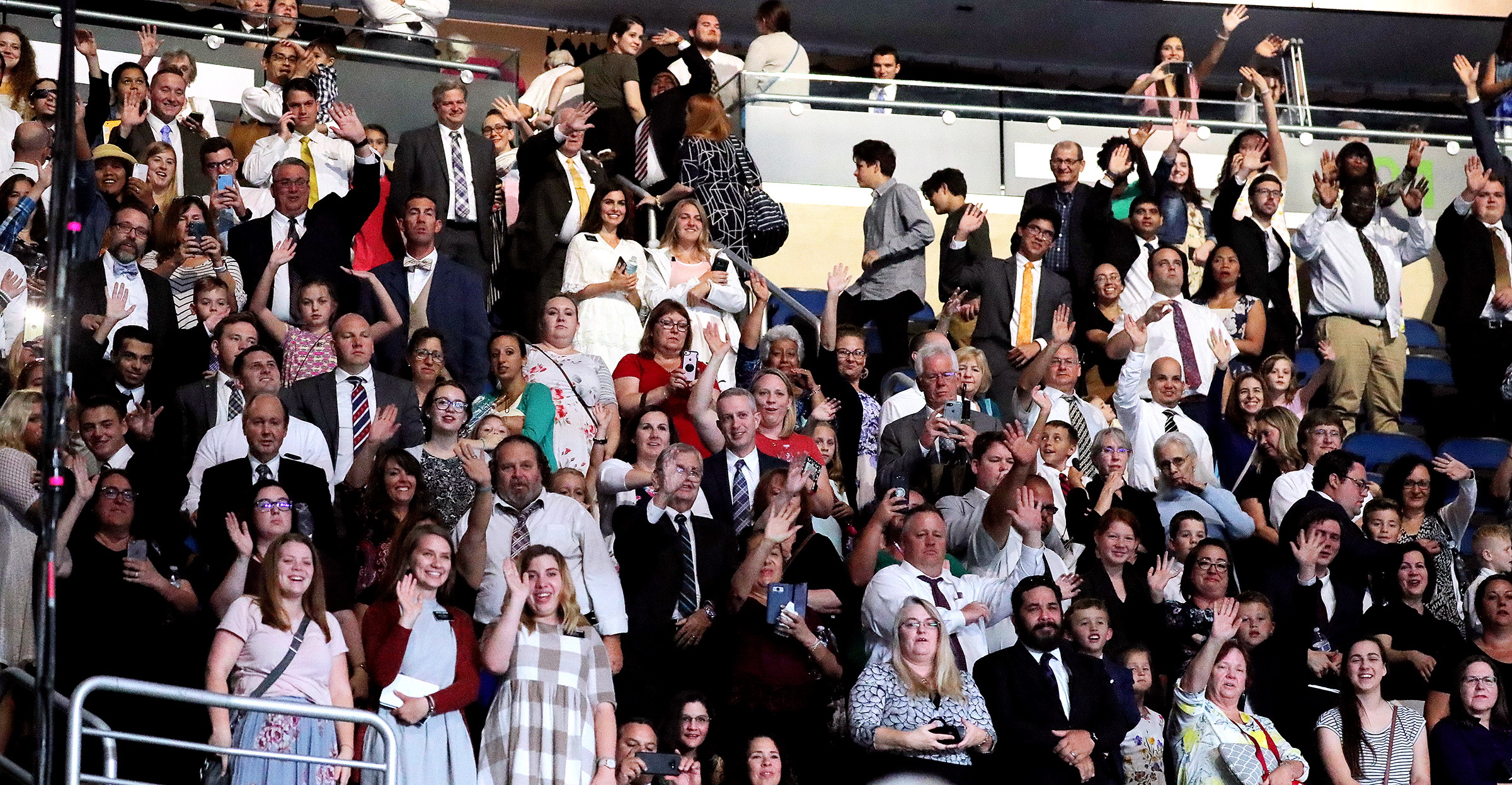Attendees wave at President Russell M. Nelson, Sister Wendy Nelson and other leaders following the June 9, 2019, devotional at the Amway Center in Orlando, Florida.